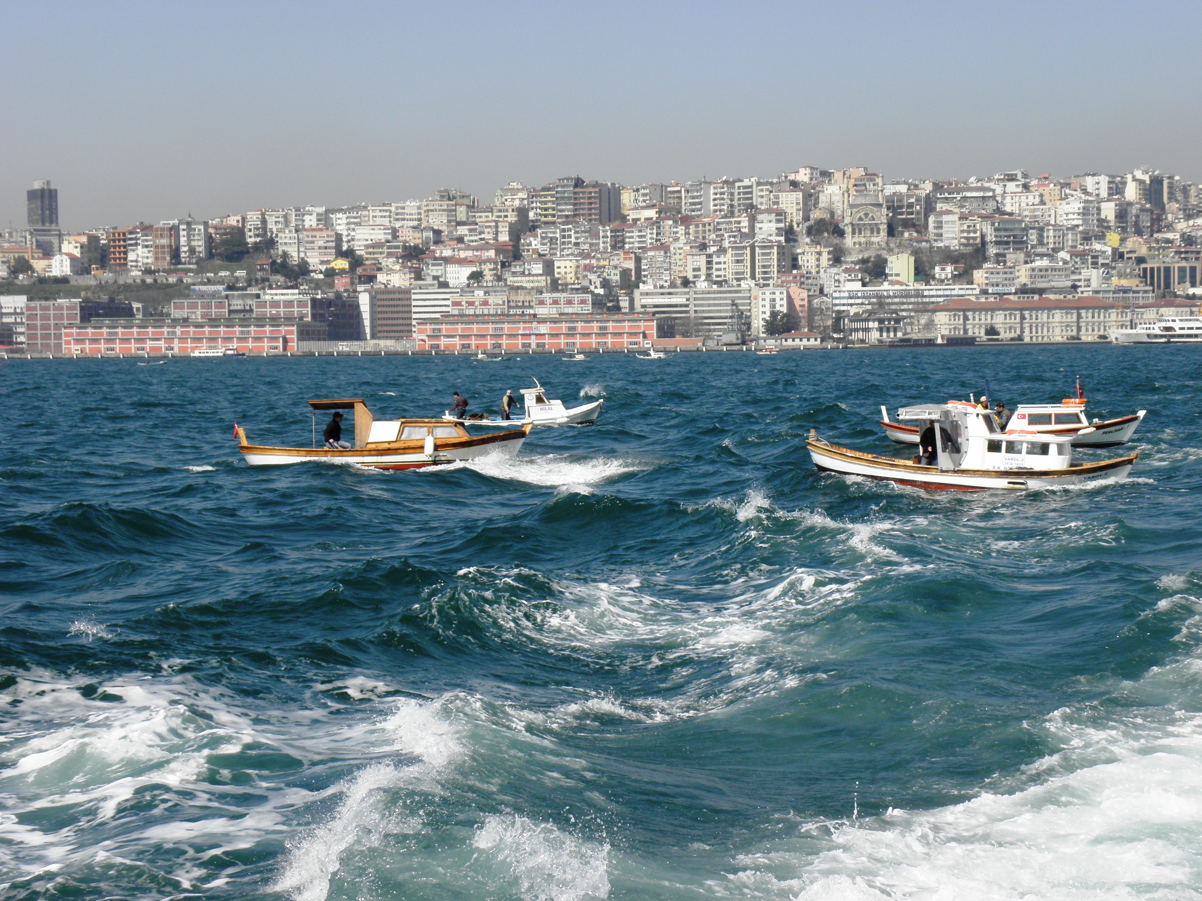 Fishing boats in the bosporus. photo