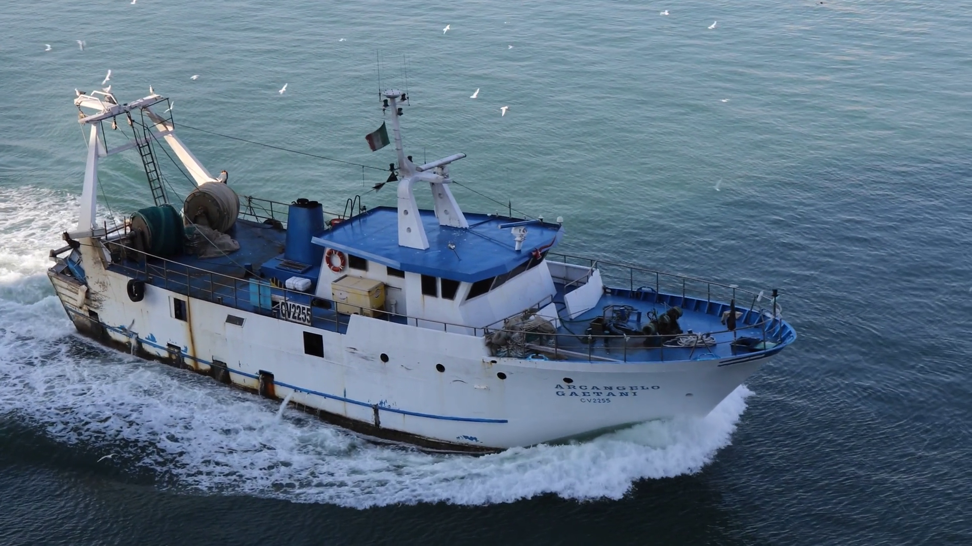 4K Fishing Trawler boat returning to port attracts seagulls Stock ...