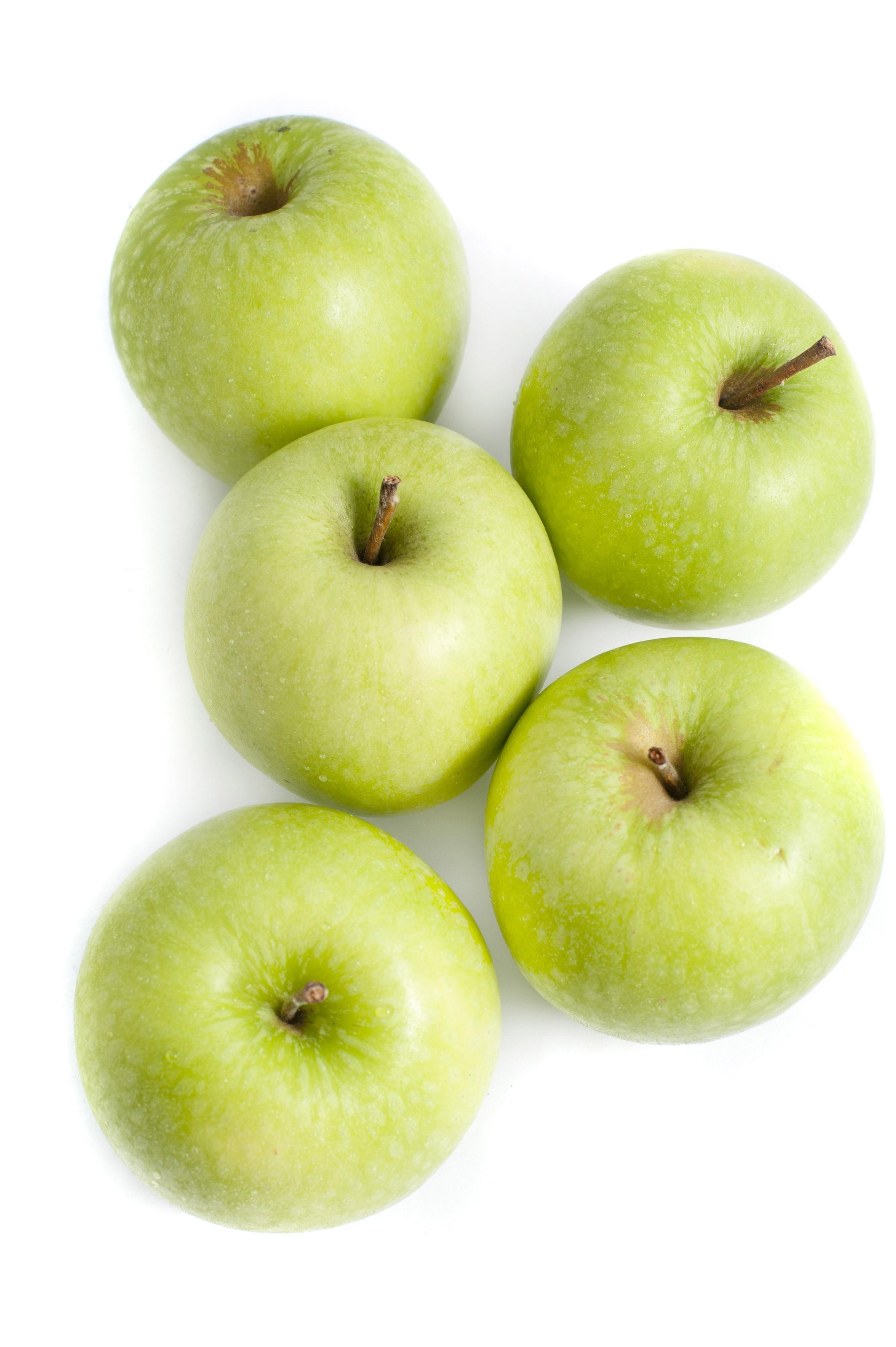 Five crisp healthy green apples - Free Stock Image