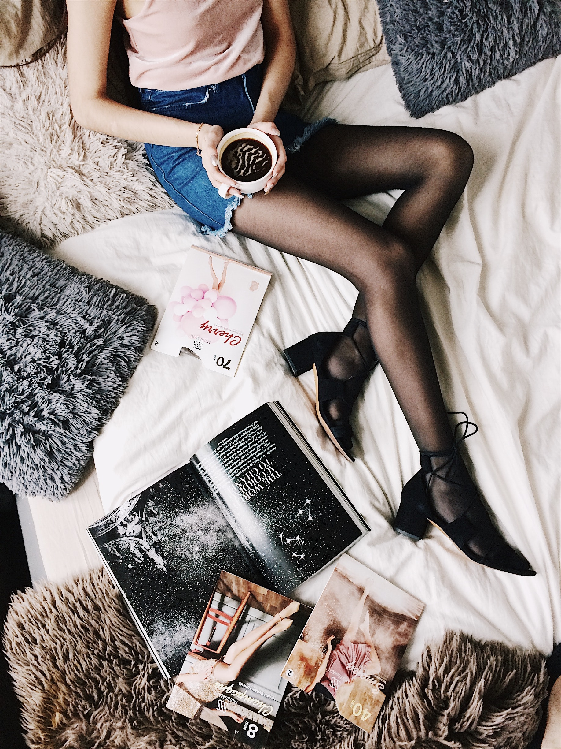 Flatlay Photography of a Woman Holding White Mug With Black Liquid While Lying on a Bed Surrounded by Fur Pillows and Magazines, Magazine, Young, Woman, Wear, HQ Photo
