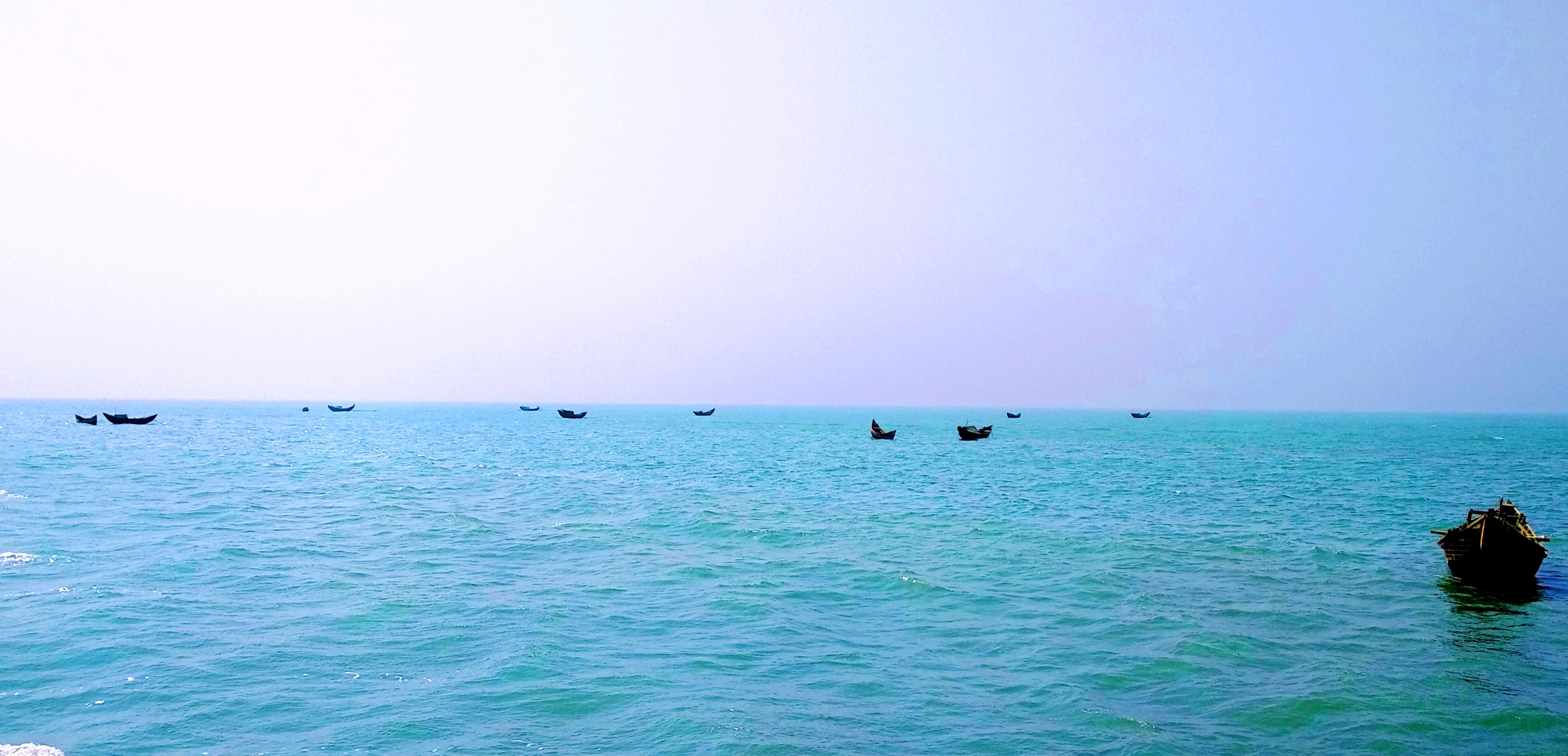 Floating fishing boat in naf river photo
