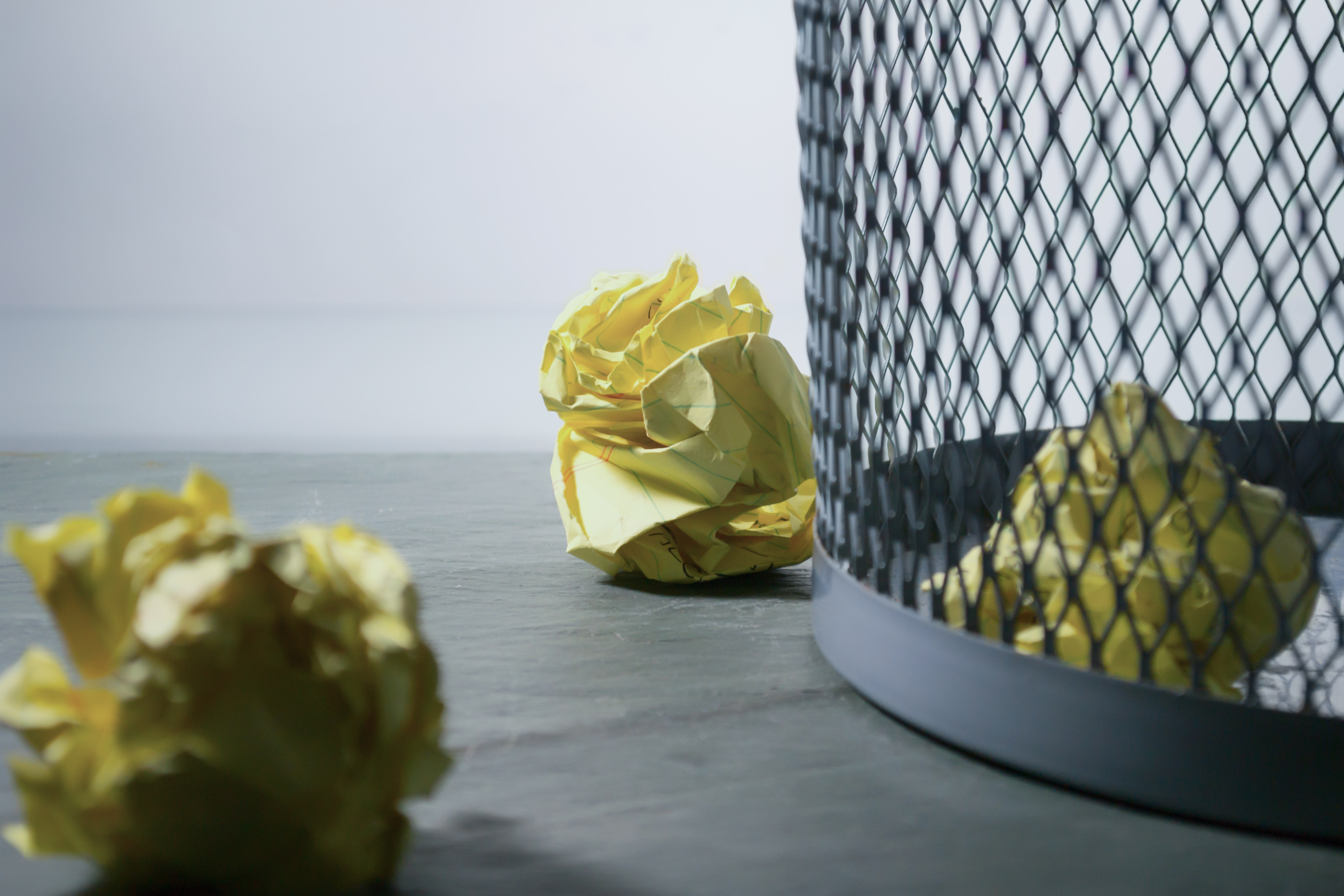 Focus Photo of Yellow Paper Near Trash Can, Blur, Close-up, Color, Crumpled, HQ Photo