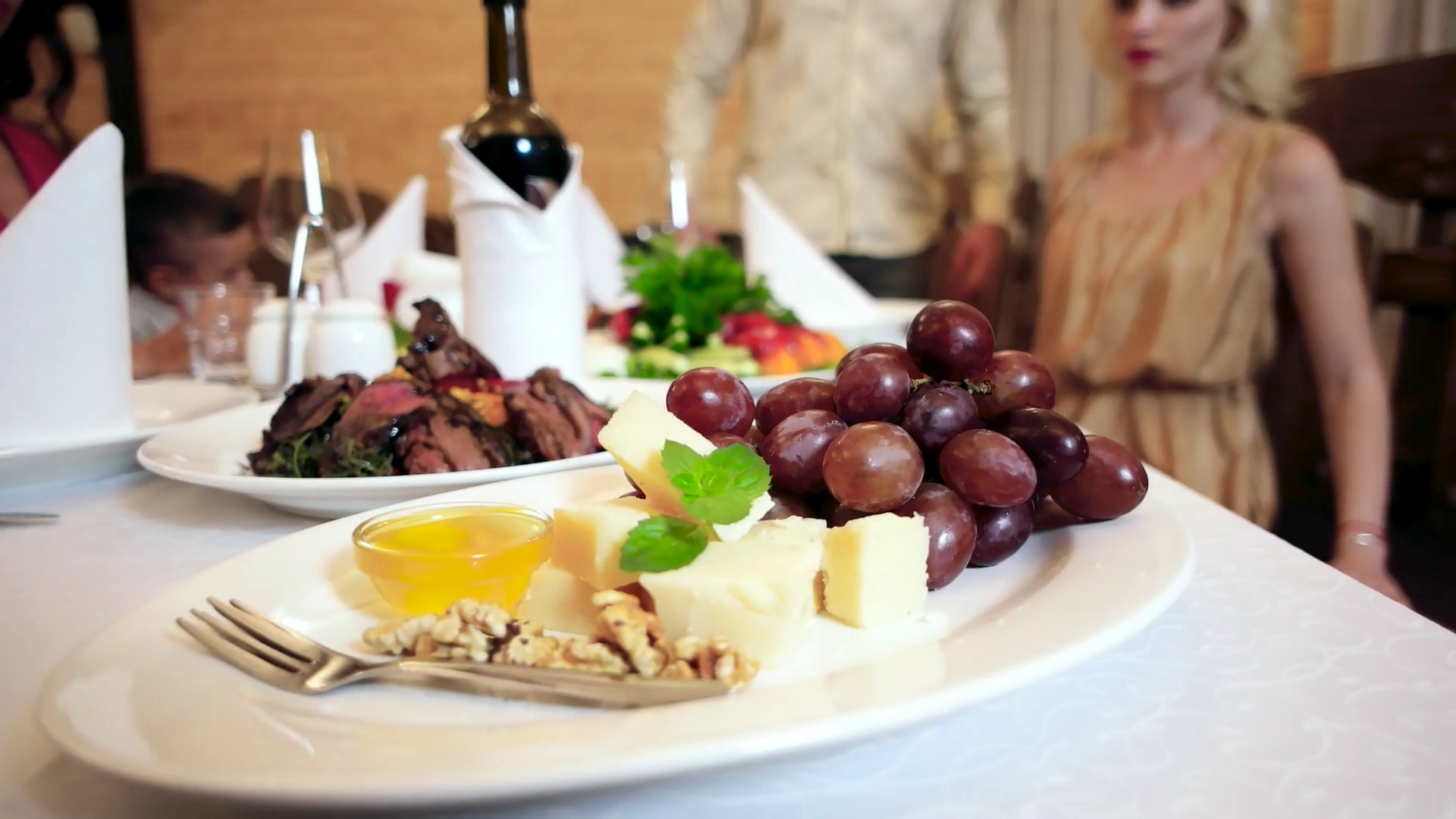 delicious food on table in the restaurant, meat, grapes, cheese ...