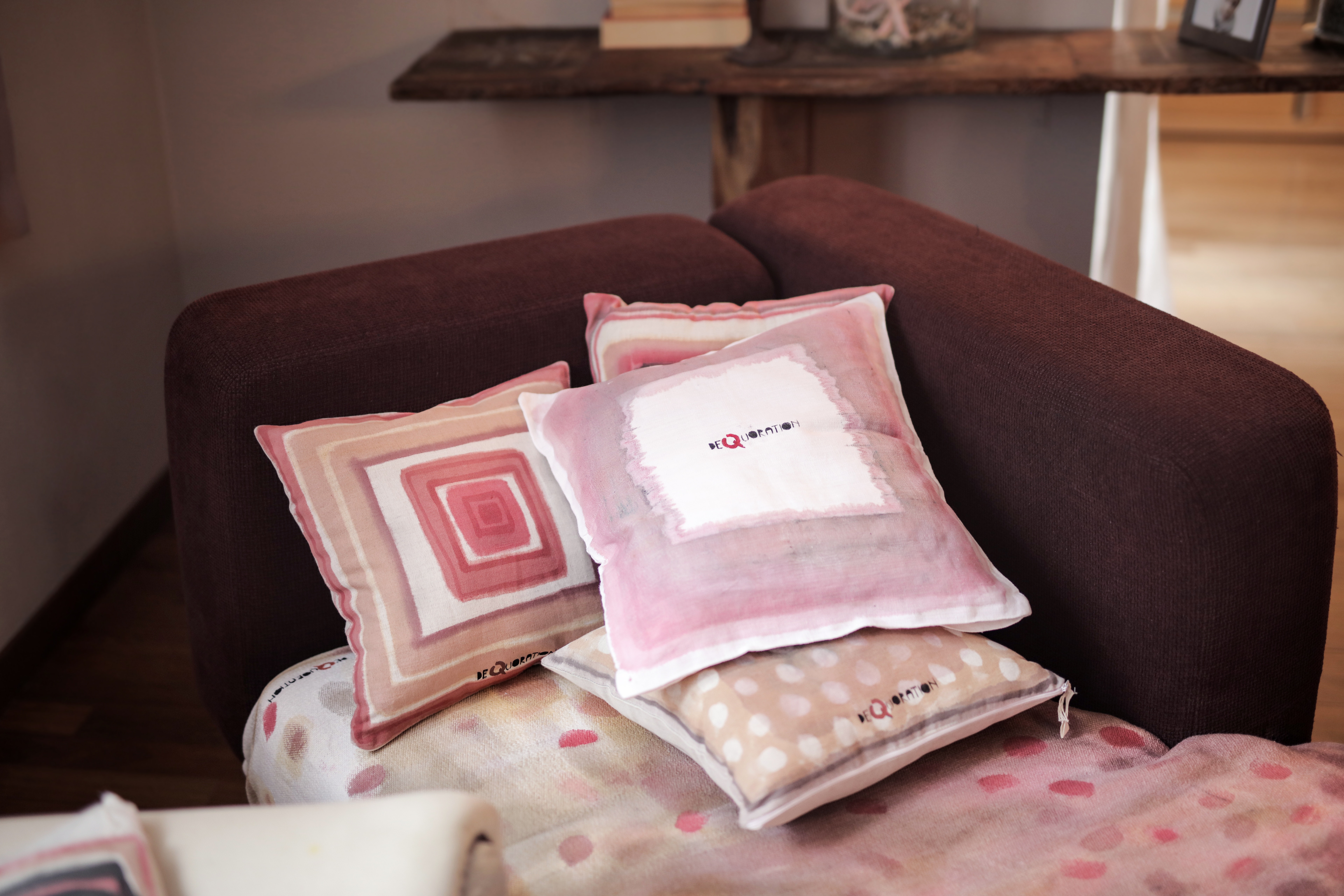 Free photo: Four Assorted-color Throw Pillows on Padded Red ...