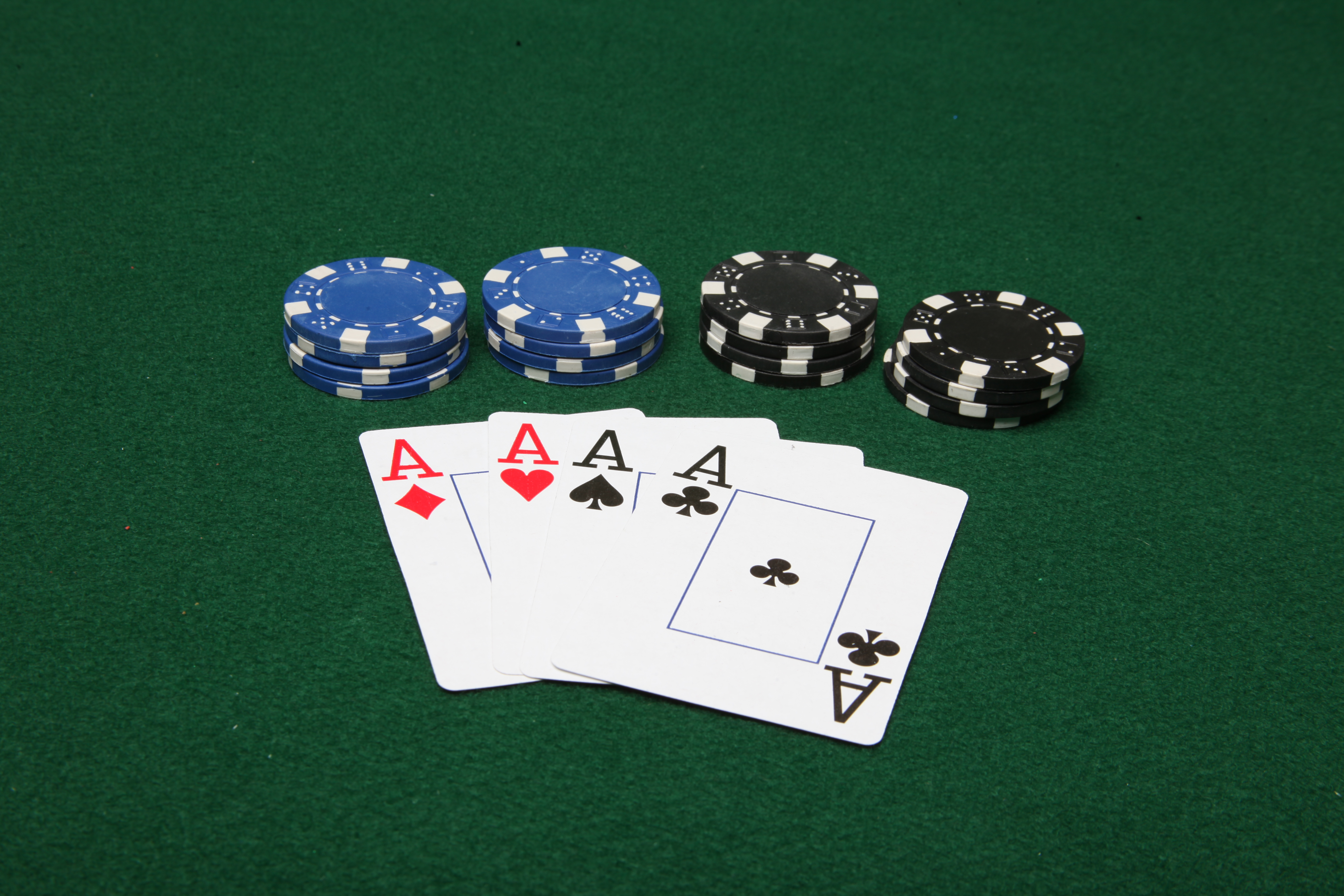 Four of a kind aces with poker chips photo