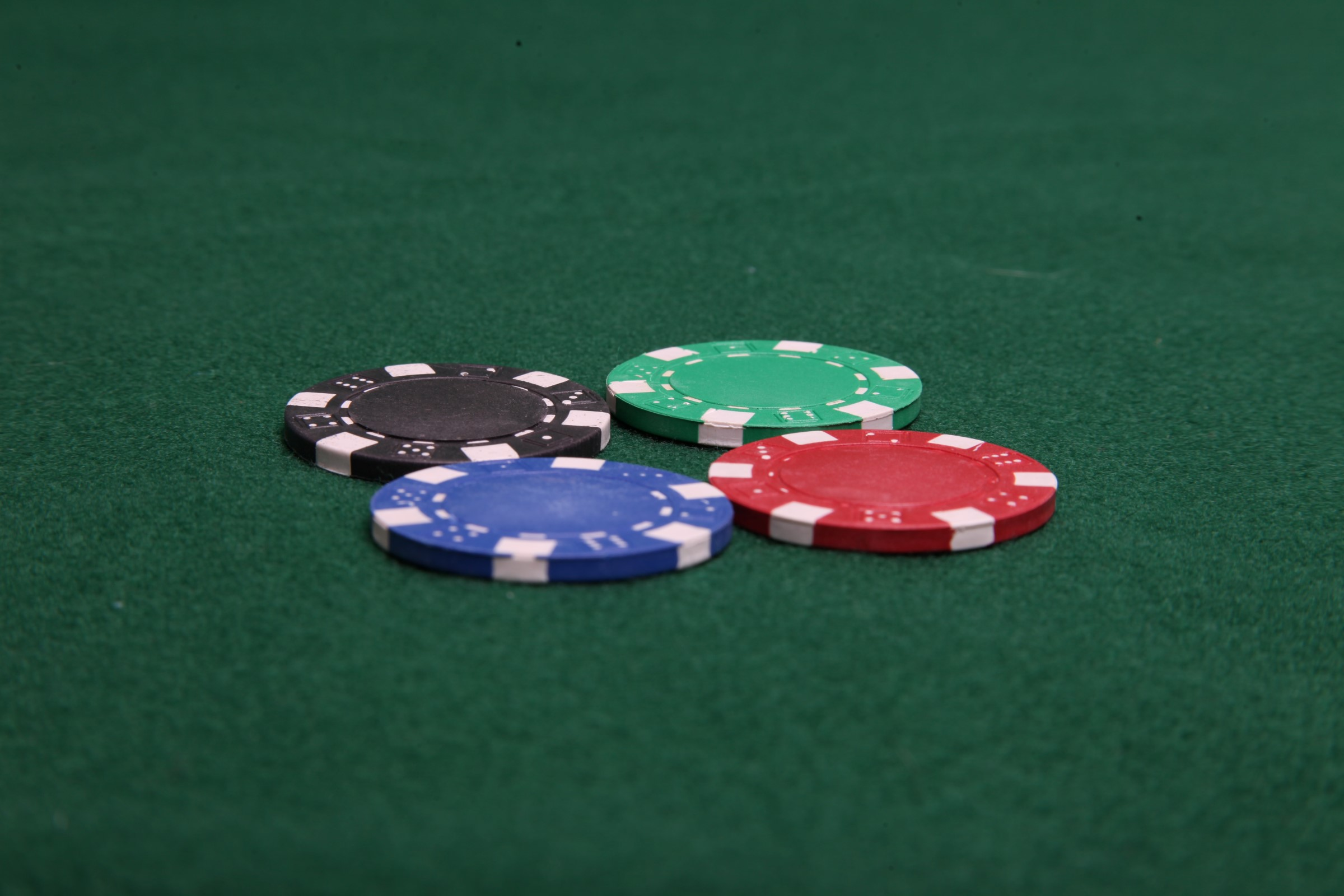 Four poker chips photo