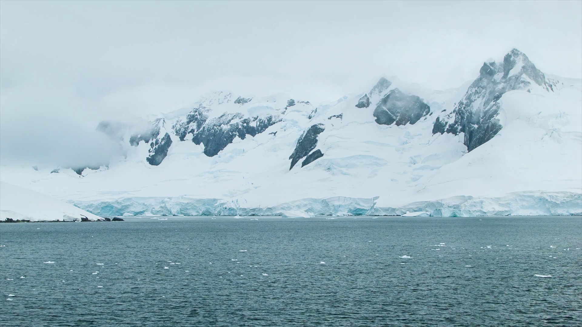 Freezing Cold Antarctica with Tall Ice Covered Mountains and Moving ...