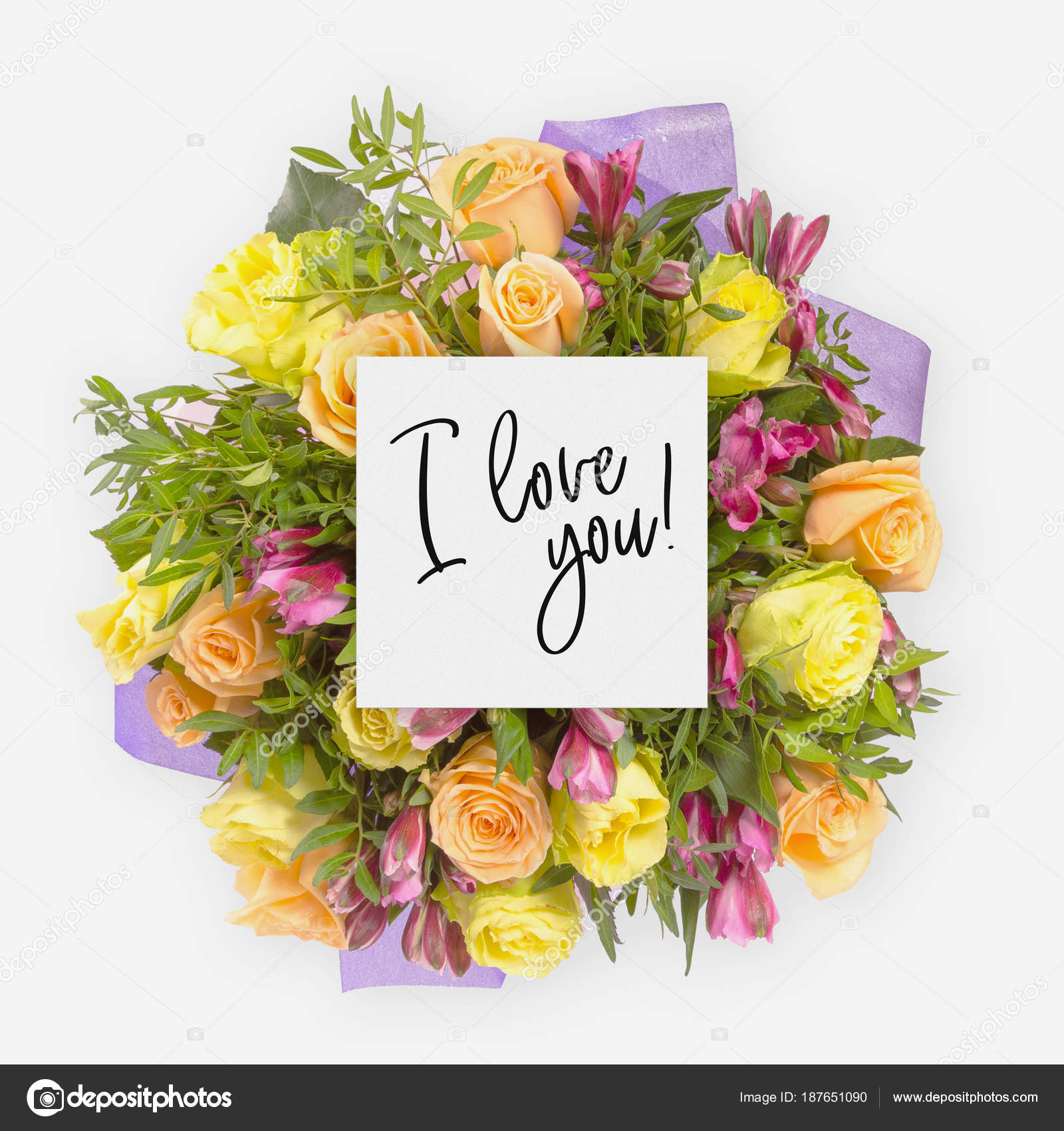 Fresh flowers bunch and card with words i love you written on it ...