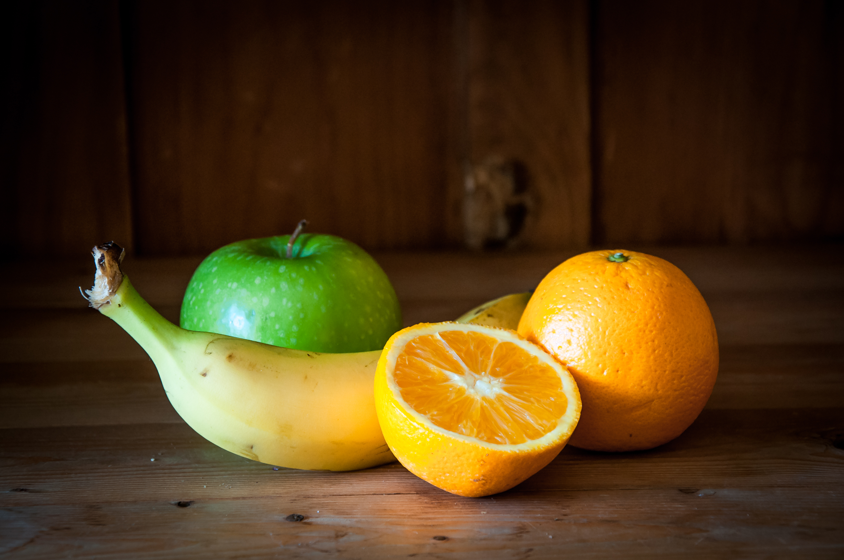 Fresh fruits on wooden background photo