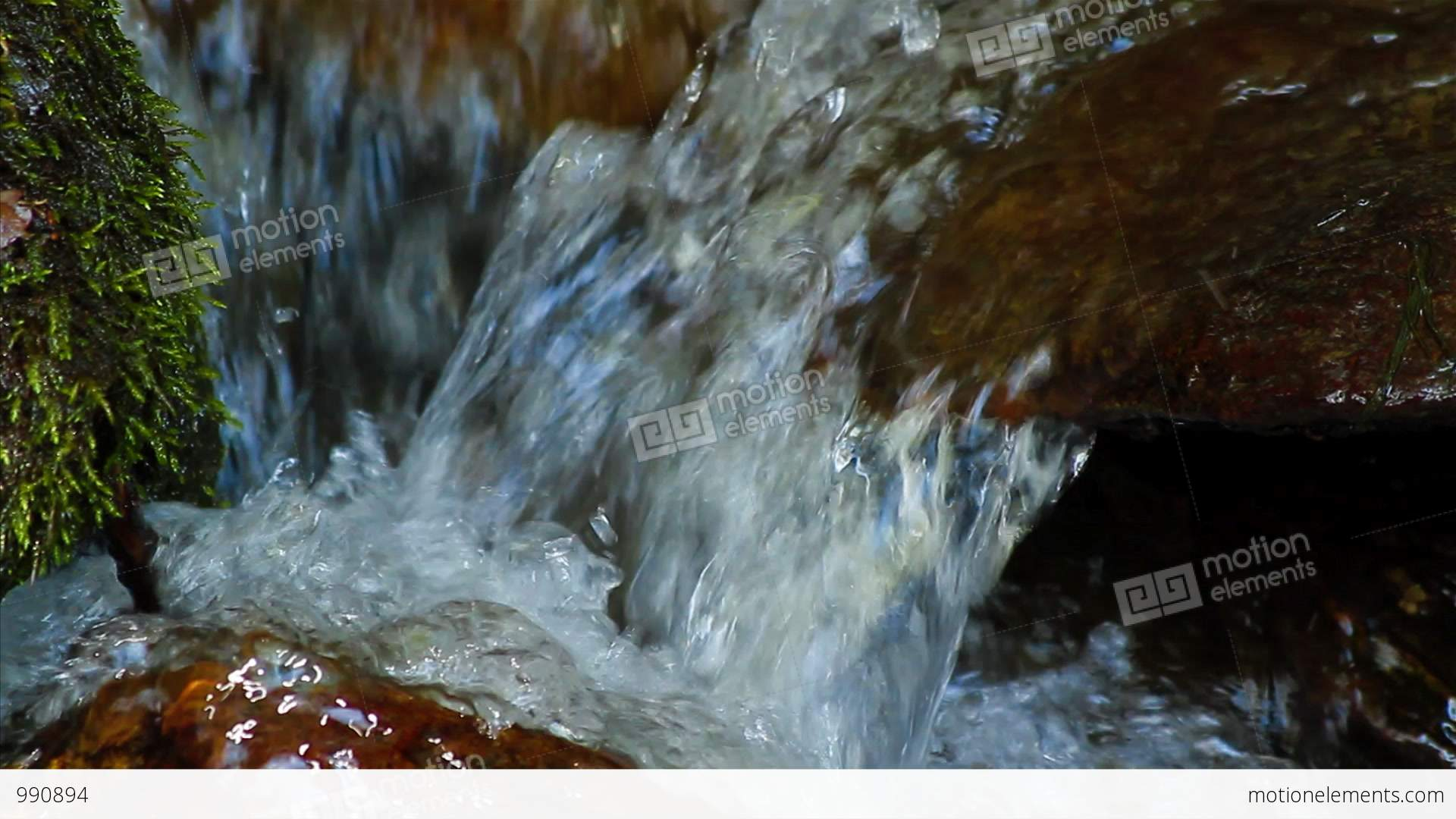 Clean Fresh Water Of A Forest Stream Running Over Mossy Rocks Stock ...