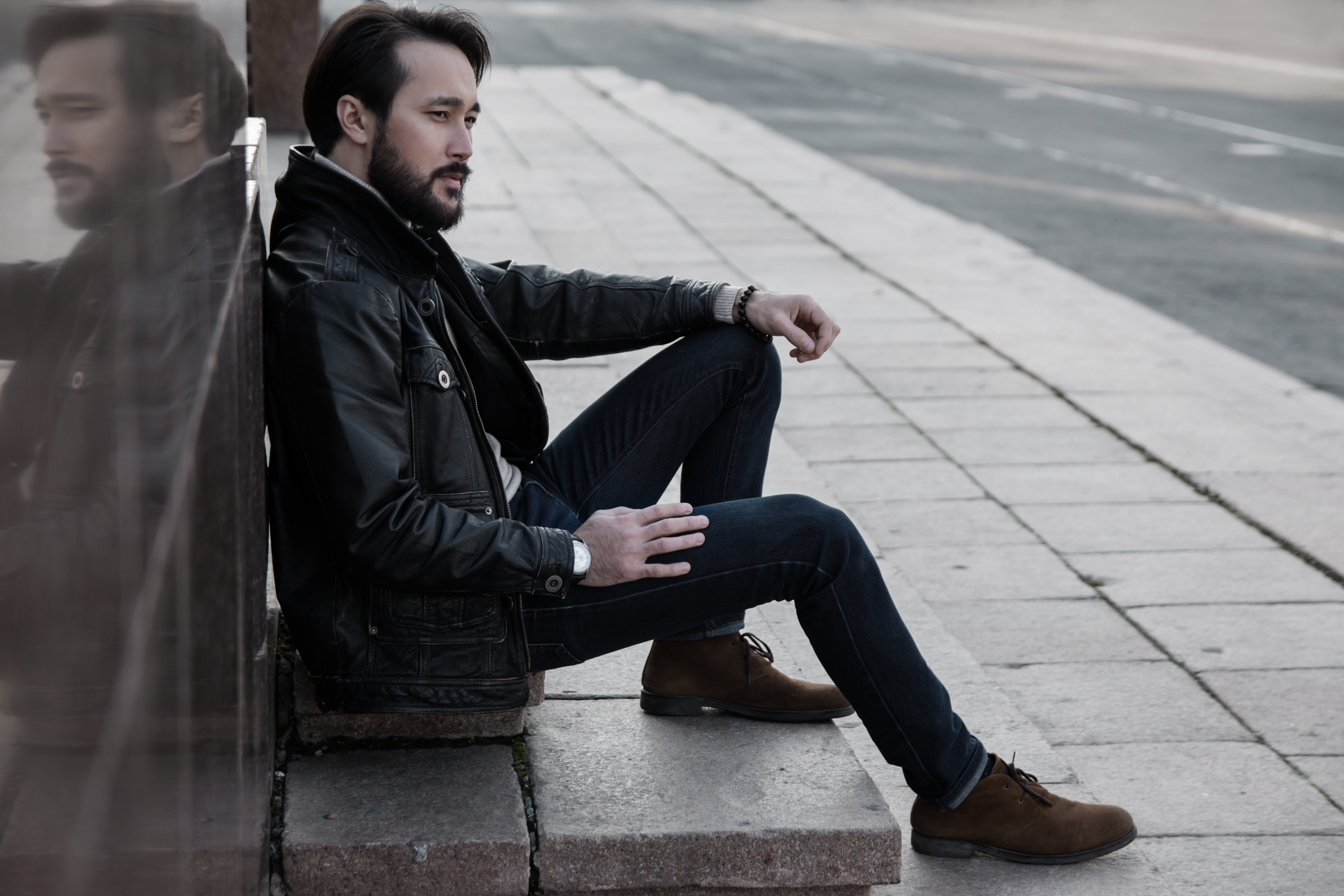 Full length of man sitting in city photo
