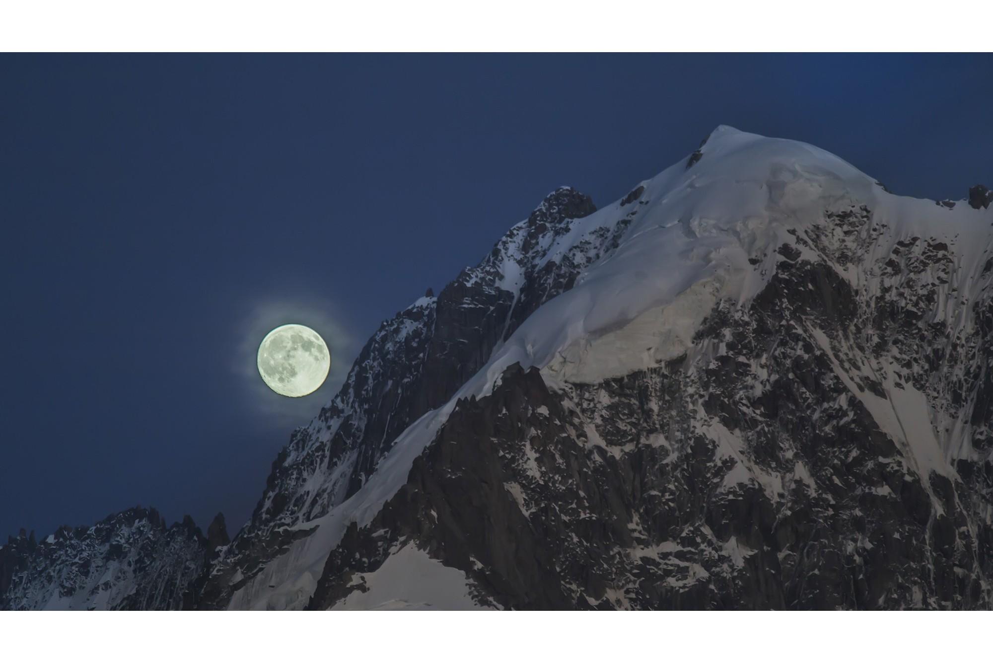 Time Lapse footage Full moon along edge Aiguille Verte - Mont Blanc