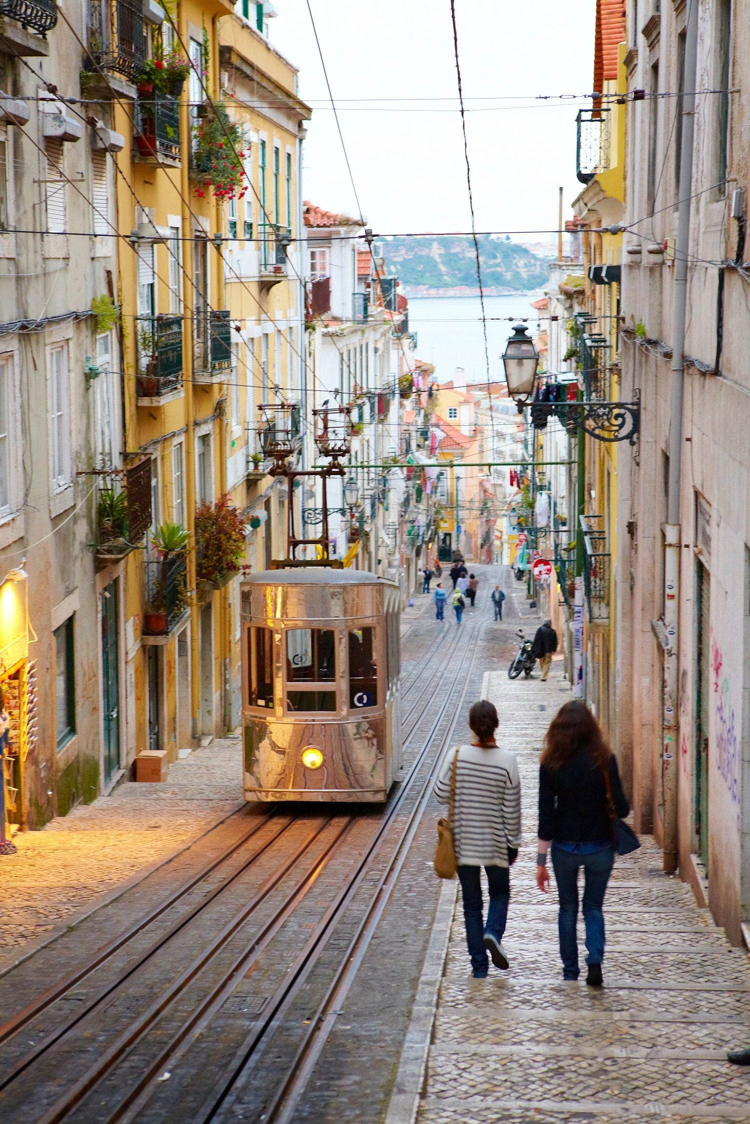Elevador da Bica funicular on a steep cobbled street in Lisbon ...
