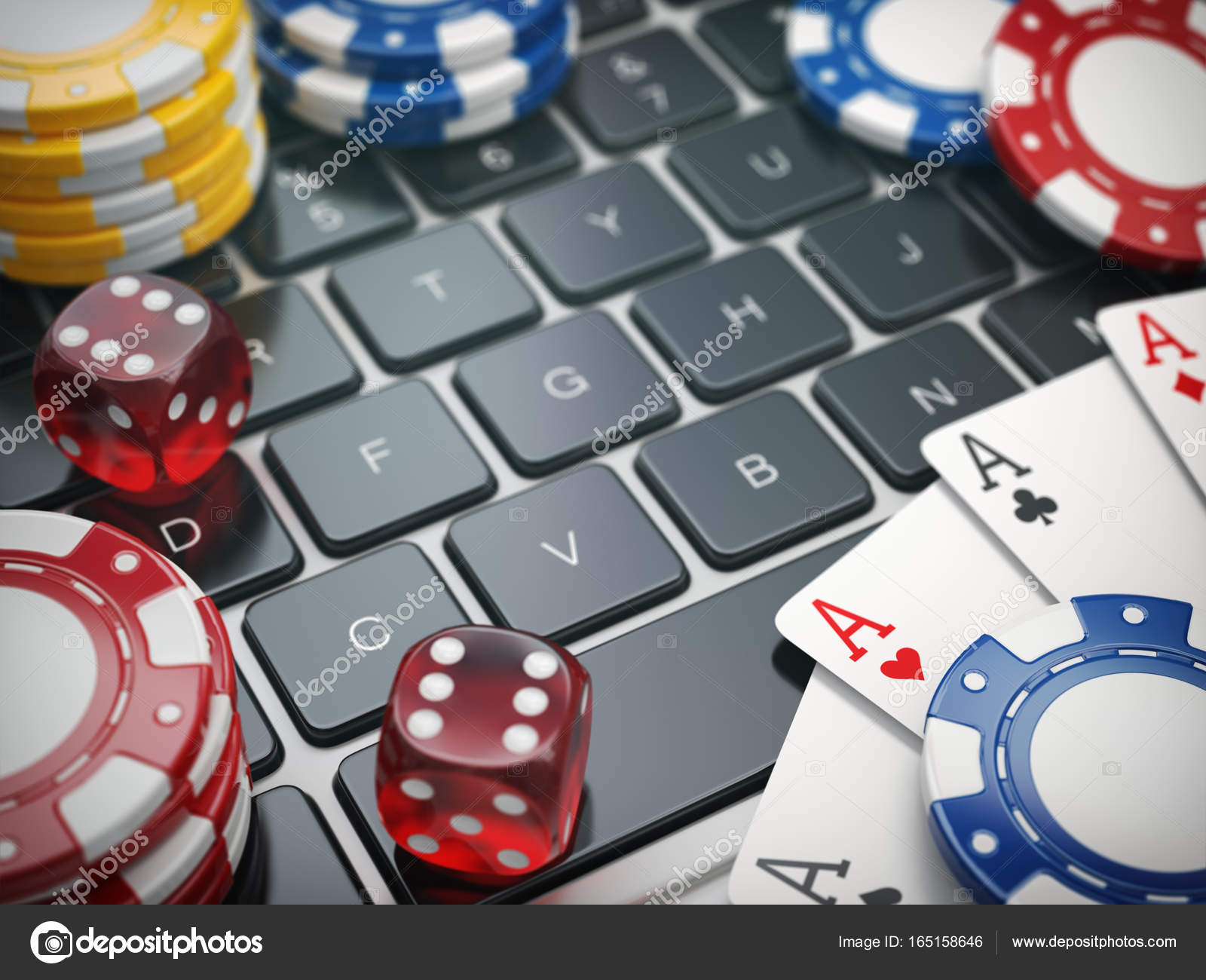 Casino online. Gambling chips , cards and dice on laptop compute ...