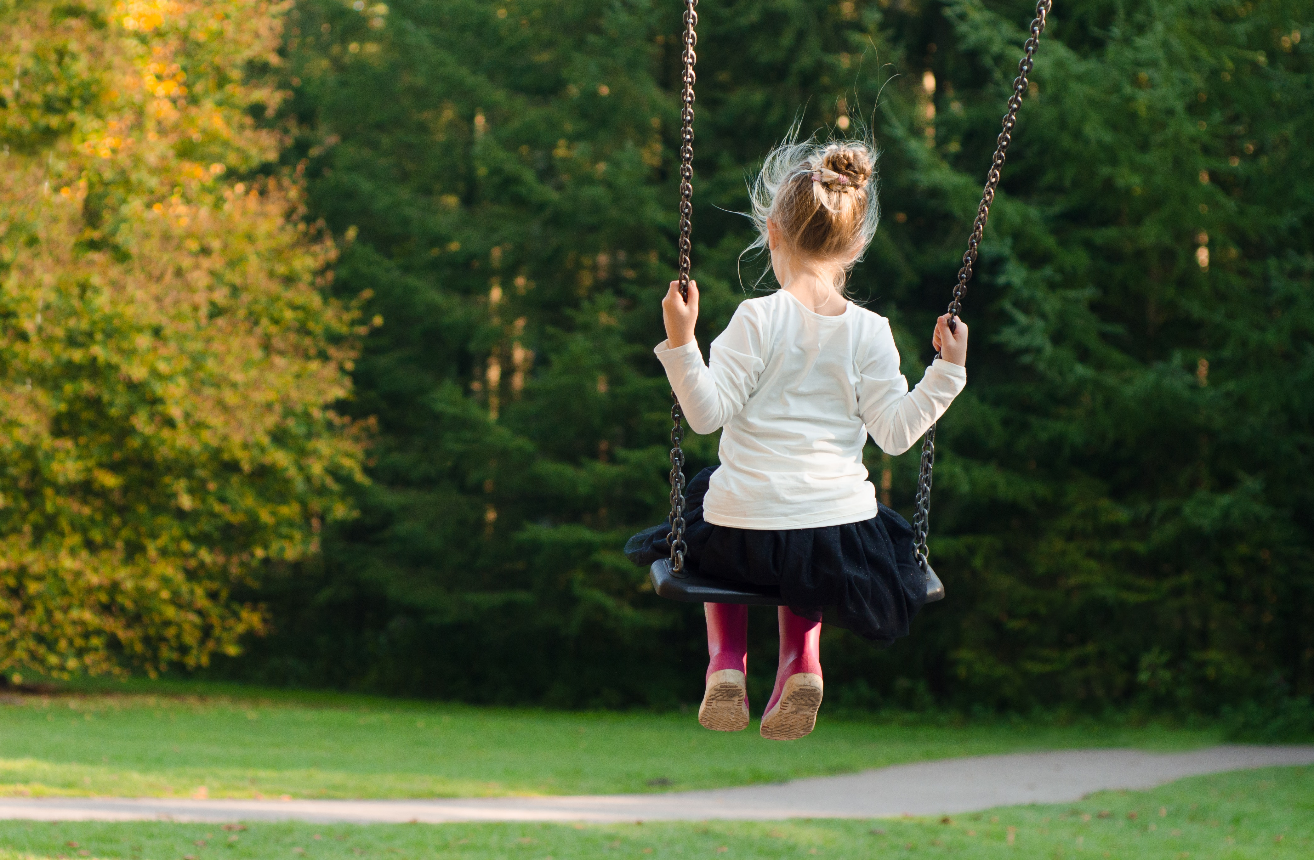 Girl in White Long Sleeve Shirt and Black Skirt Sitting on Swing during Day Time, Trees, Young, Swing, Person, HQ Photo