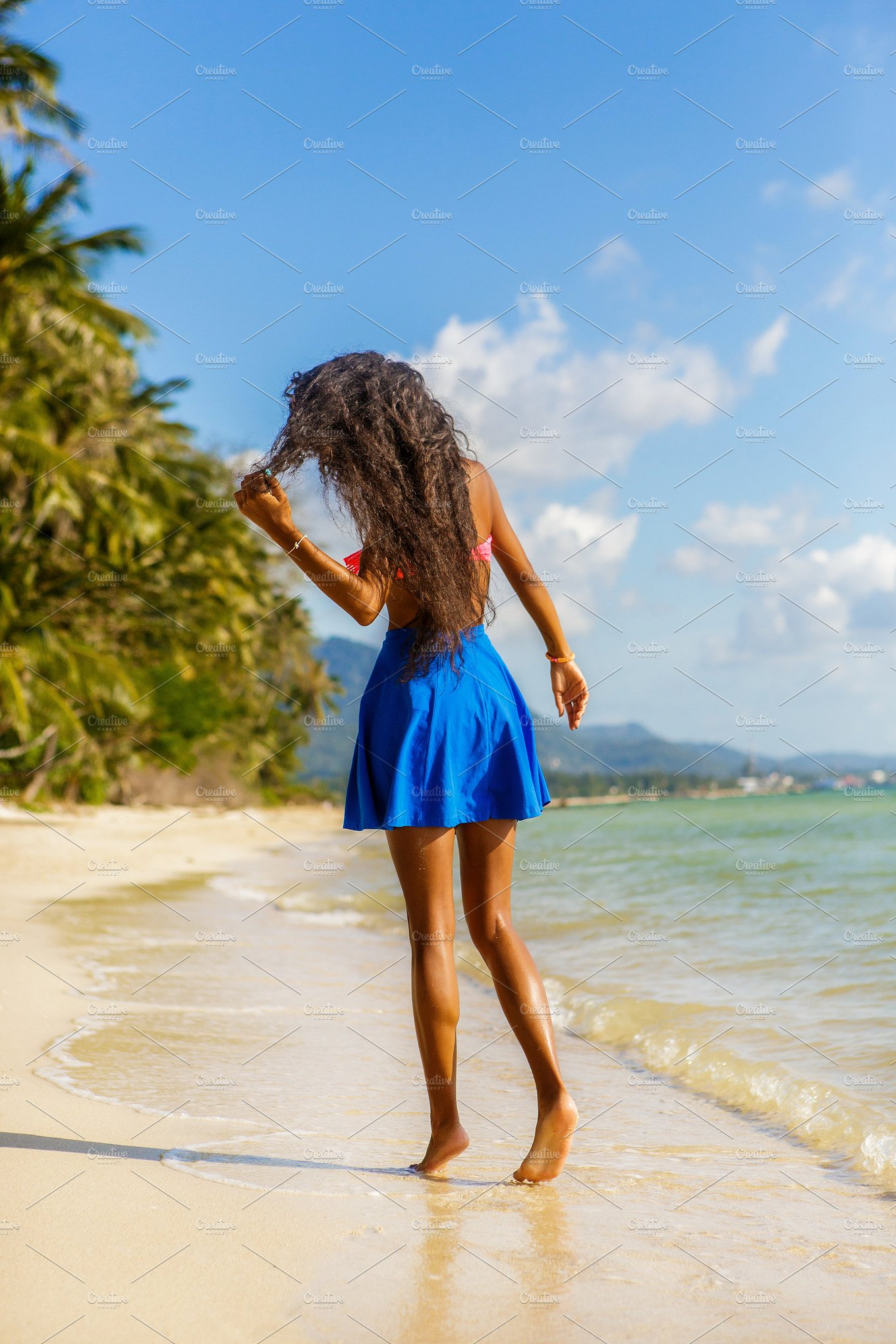 Beautiful black girl at the beach. ~ People Photos ~ Creative Market