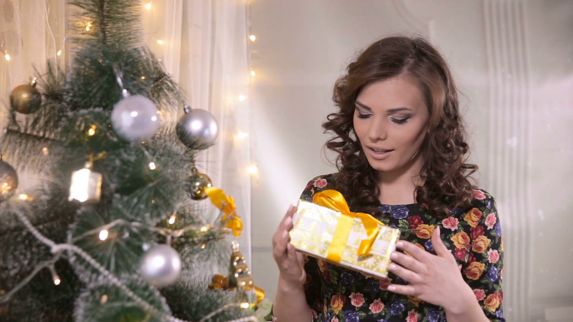 Beauty girl with christmas gift box. Young cute woman happy getting ...