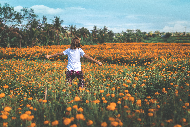 Free photo girl running on yellow flowers orange outdoors girl running on yellow flowers photo mightylinksfo