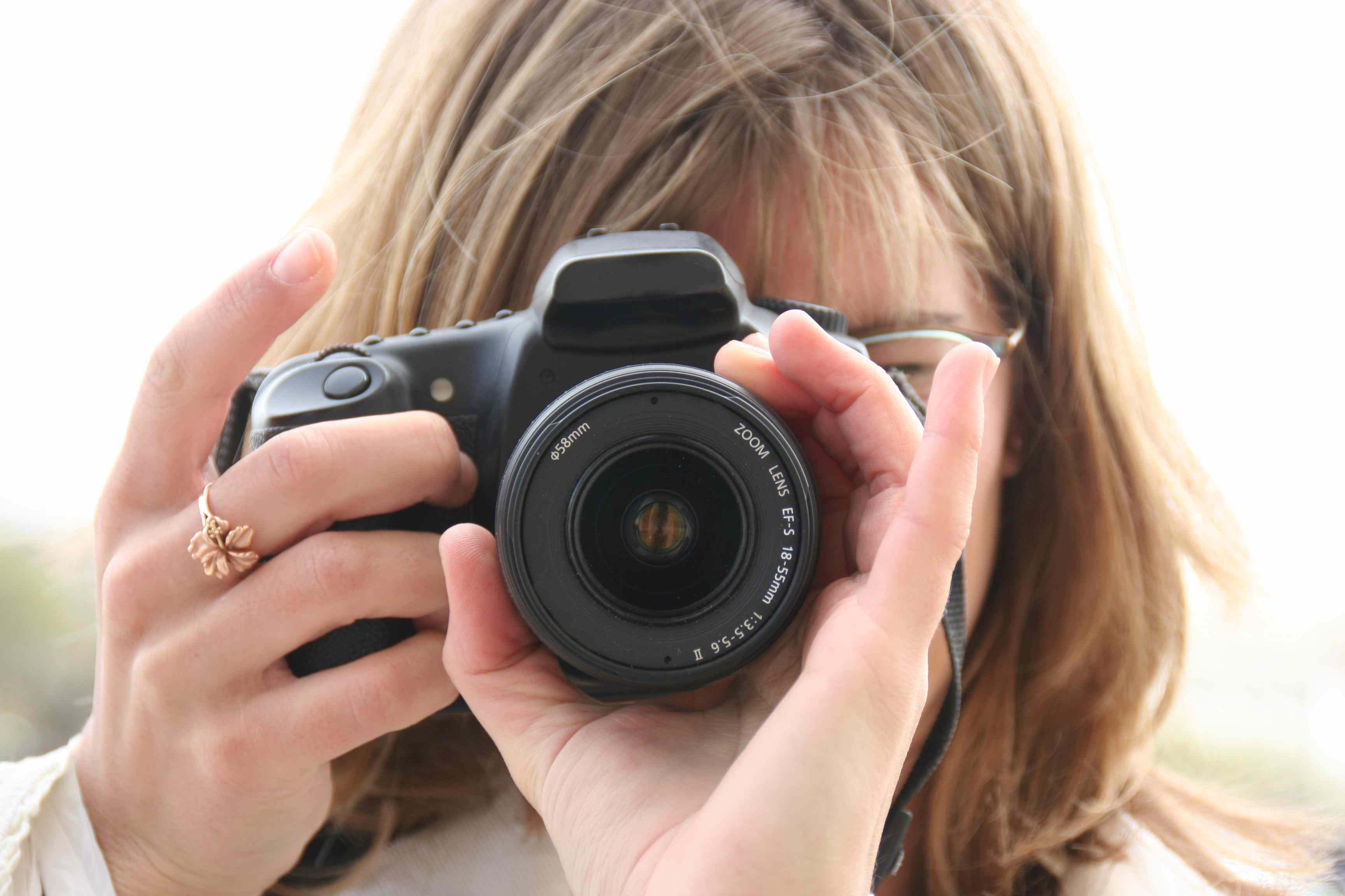 Girl-Taking-Photograph-With-Camera   Karen Gately
