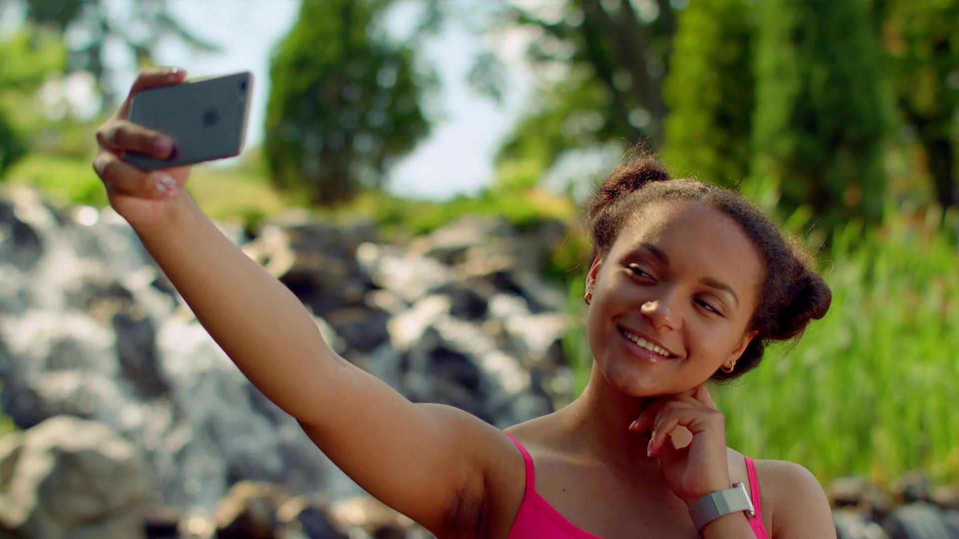 Selfie girl. Close up of latin girl taking selfie photo. Mulatto ...