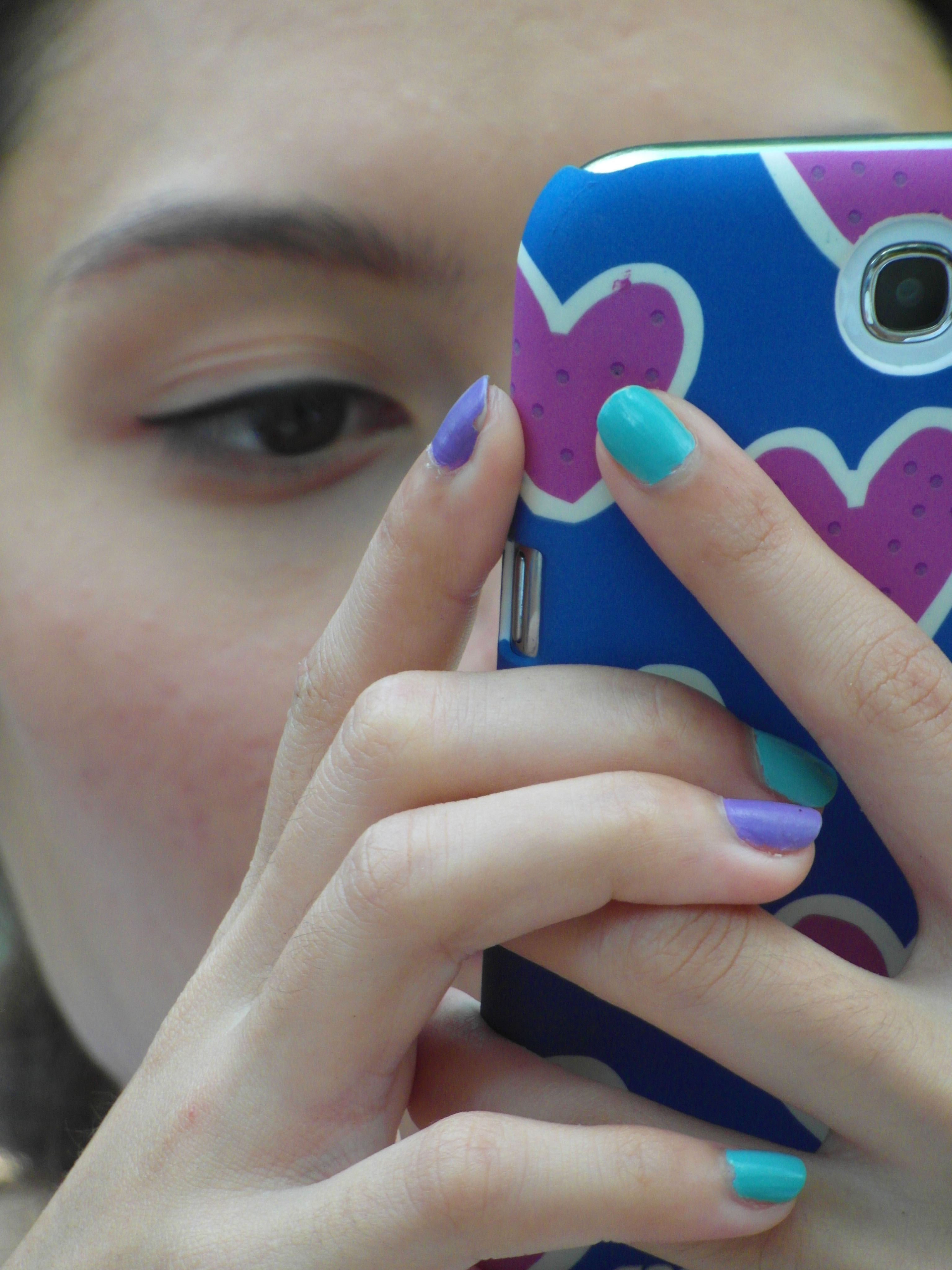 Girl using touch screen phone photo