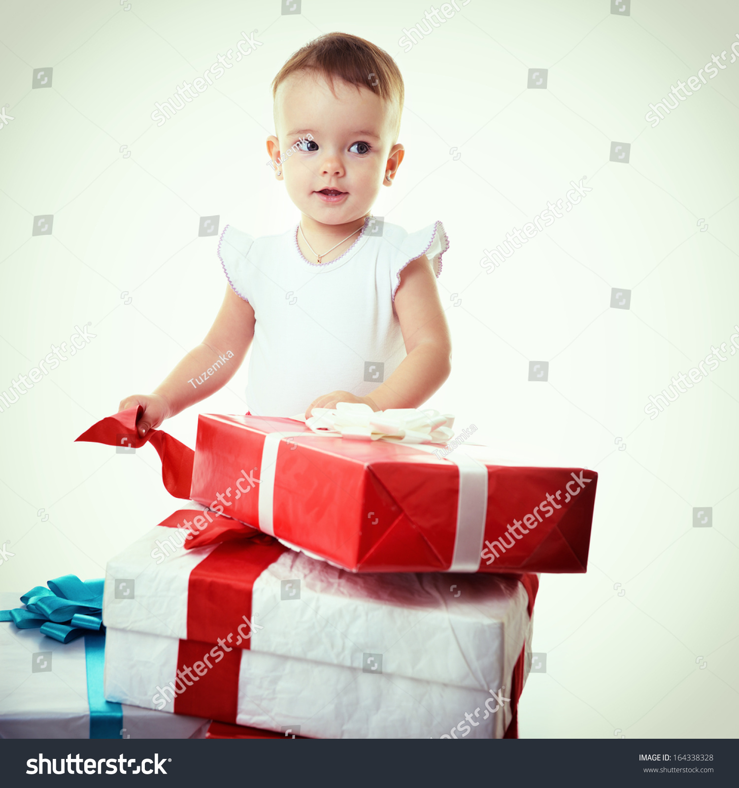 Holidays Baby Girl Opening Box Presents Stock Photo & Image (Royalty ...