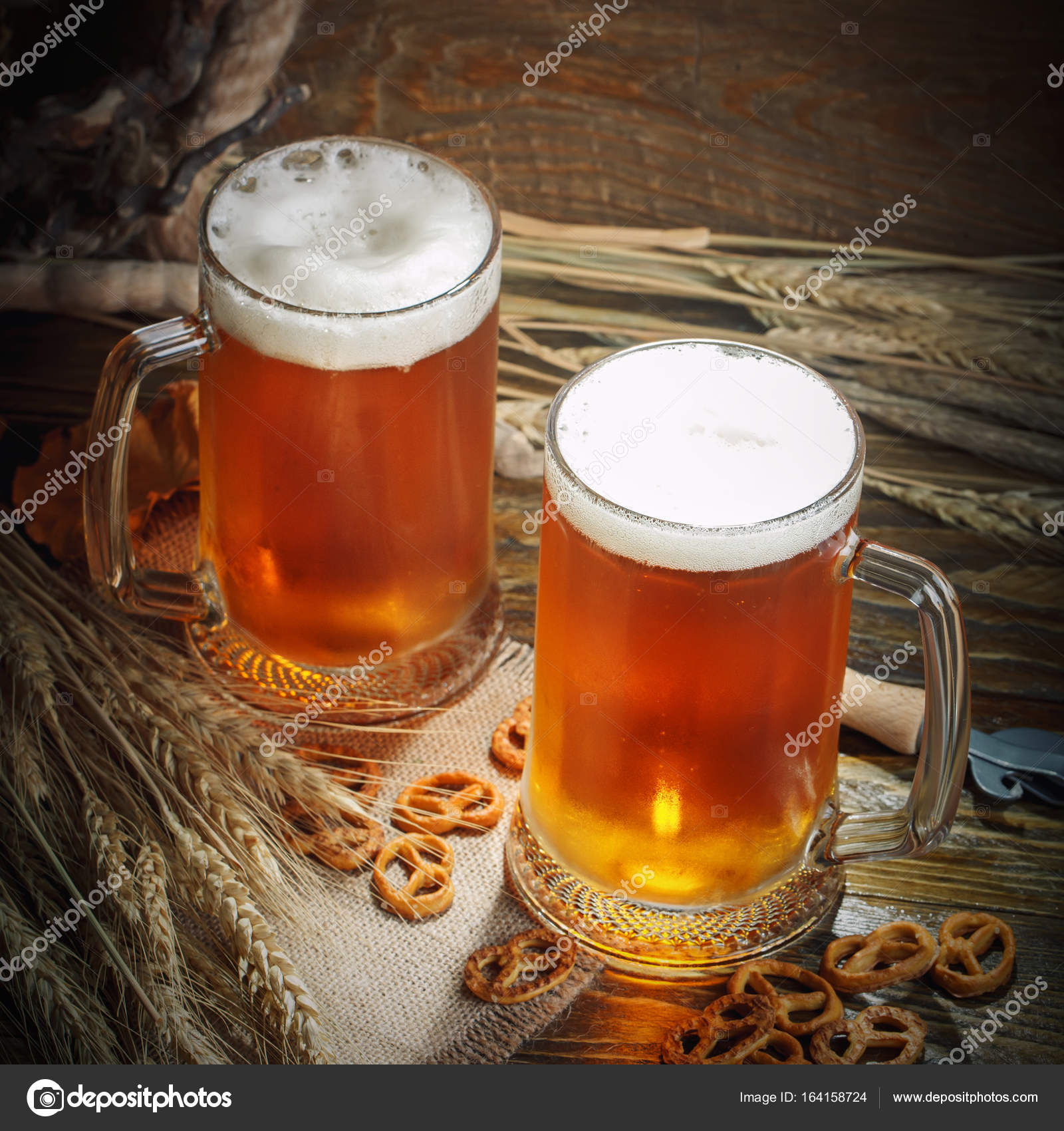 Glasses of fresh beer on a wooden table. — Stock Photo © NyuraUsova ...