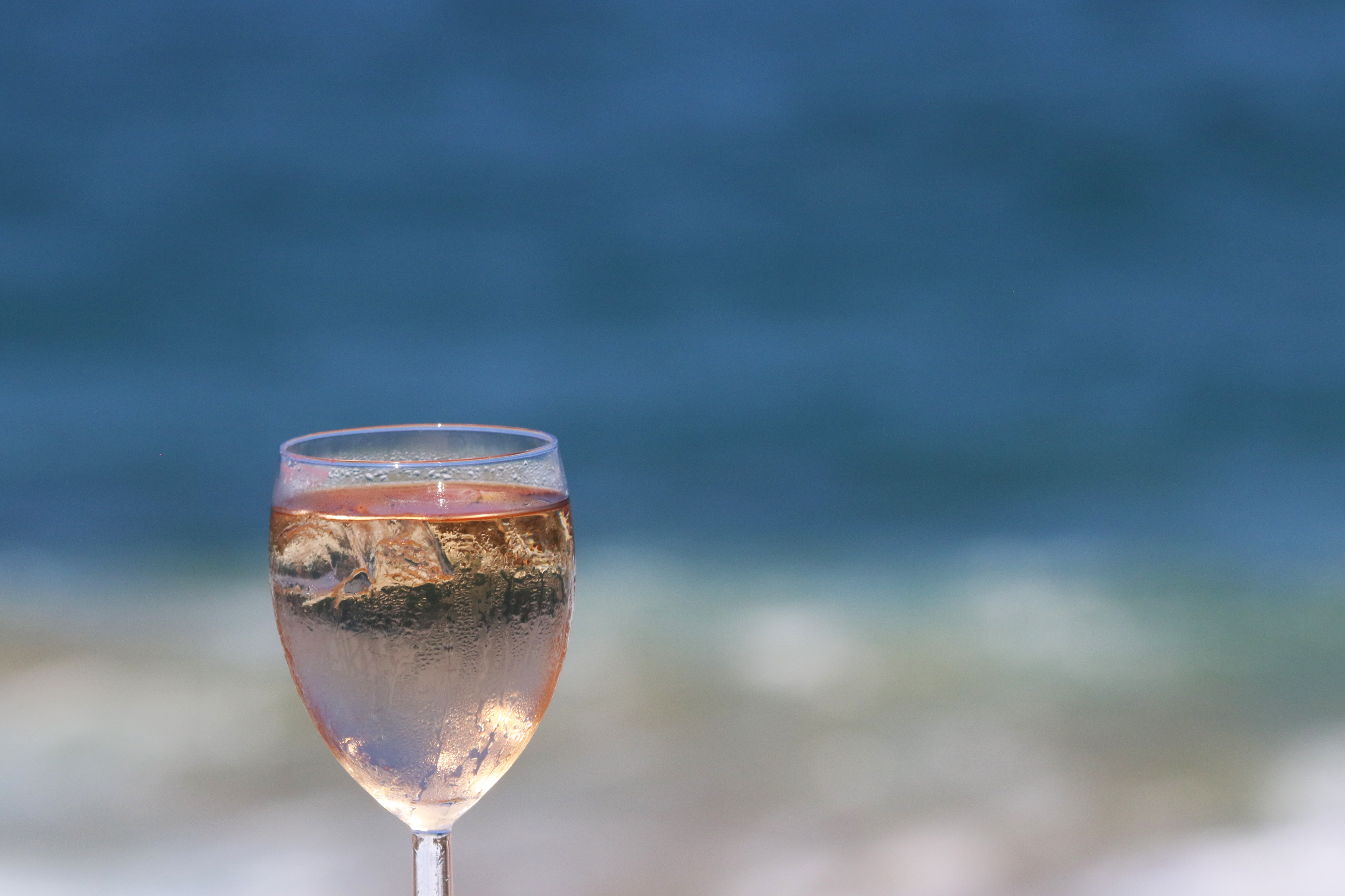Glass of rose wine with ice photo