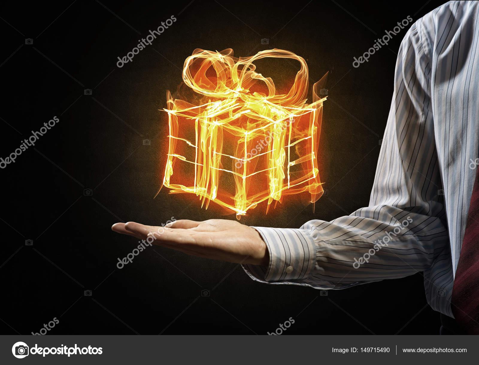 Glowing fire gift box — Stock Photo © Khakimullin #149715490
