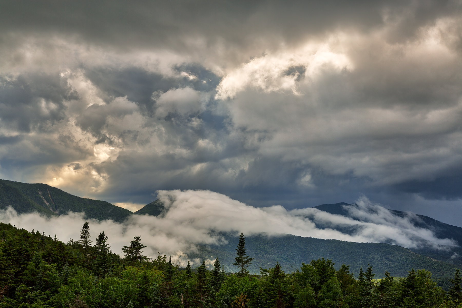 Glowing white mountain clouds - hdr photo