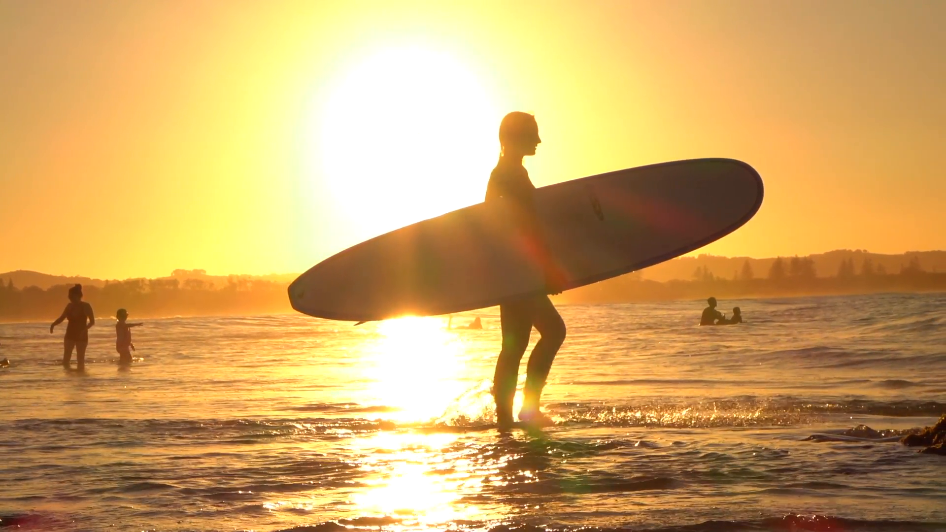 Surfer with surfboard photo