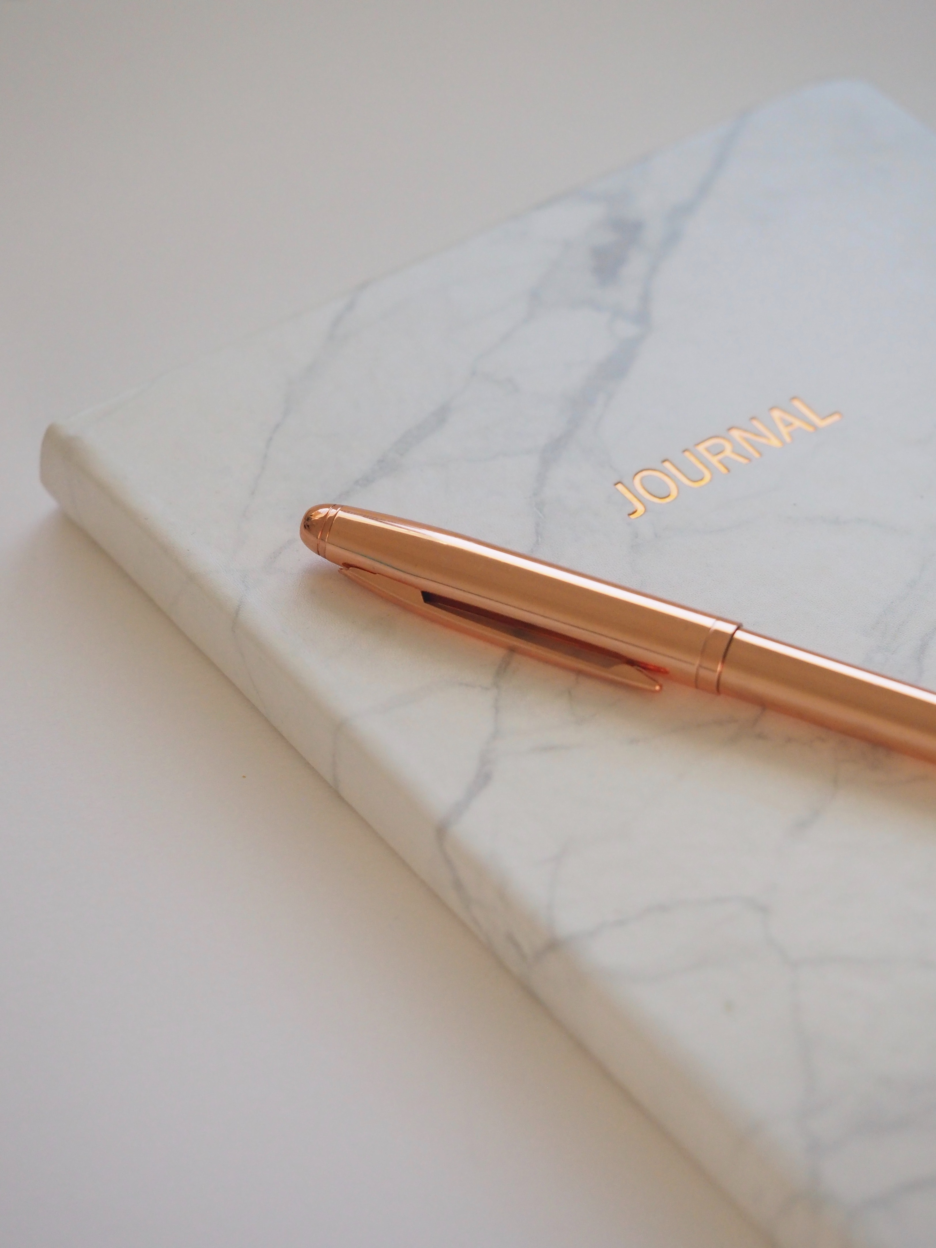 Gold pen on journal book photo