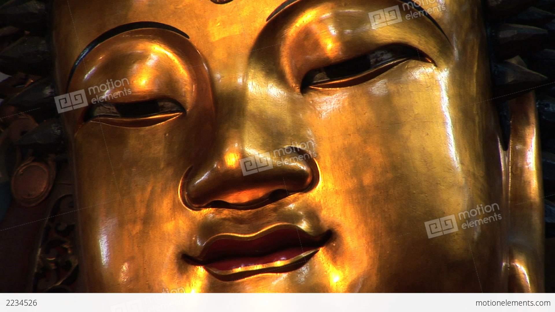 Golden Buddha Face Stock video footage | 2234526