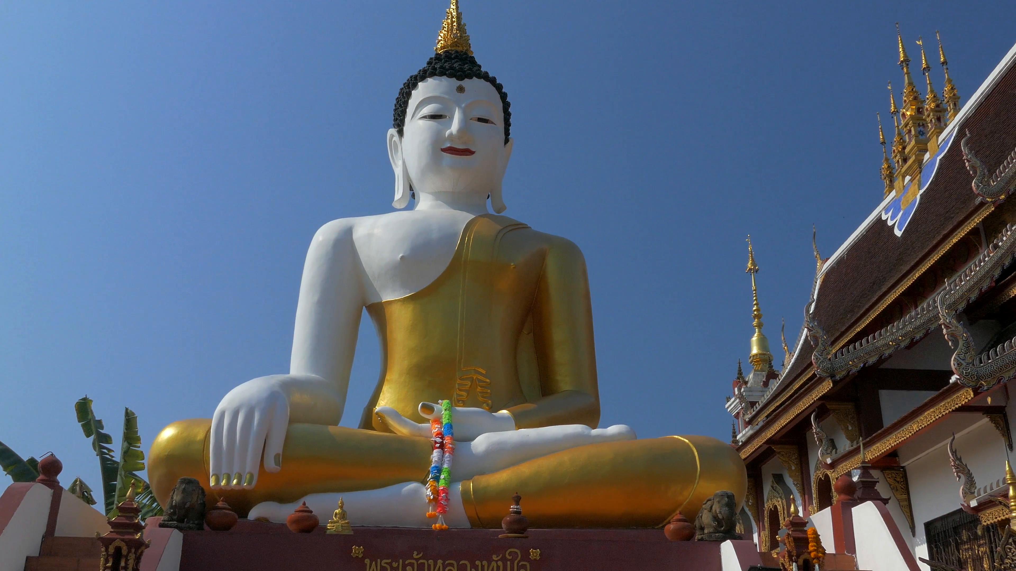 Big Golden Buddha statue in Chiang Mai, Thailand. Panning shot ...