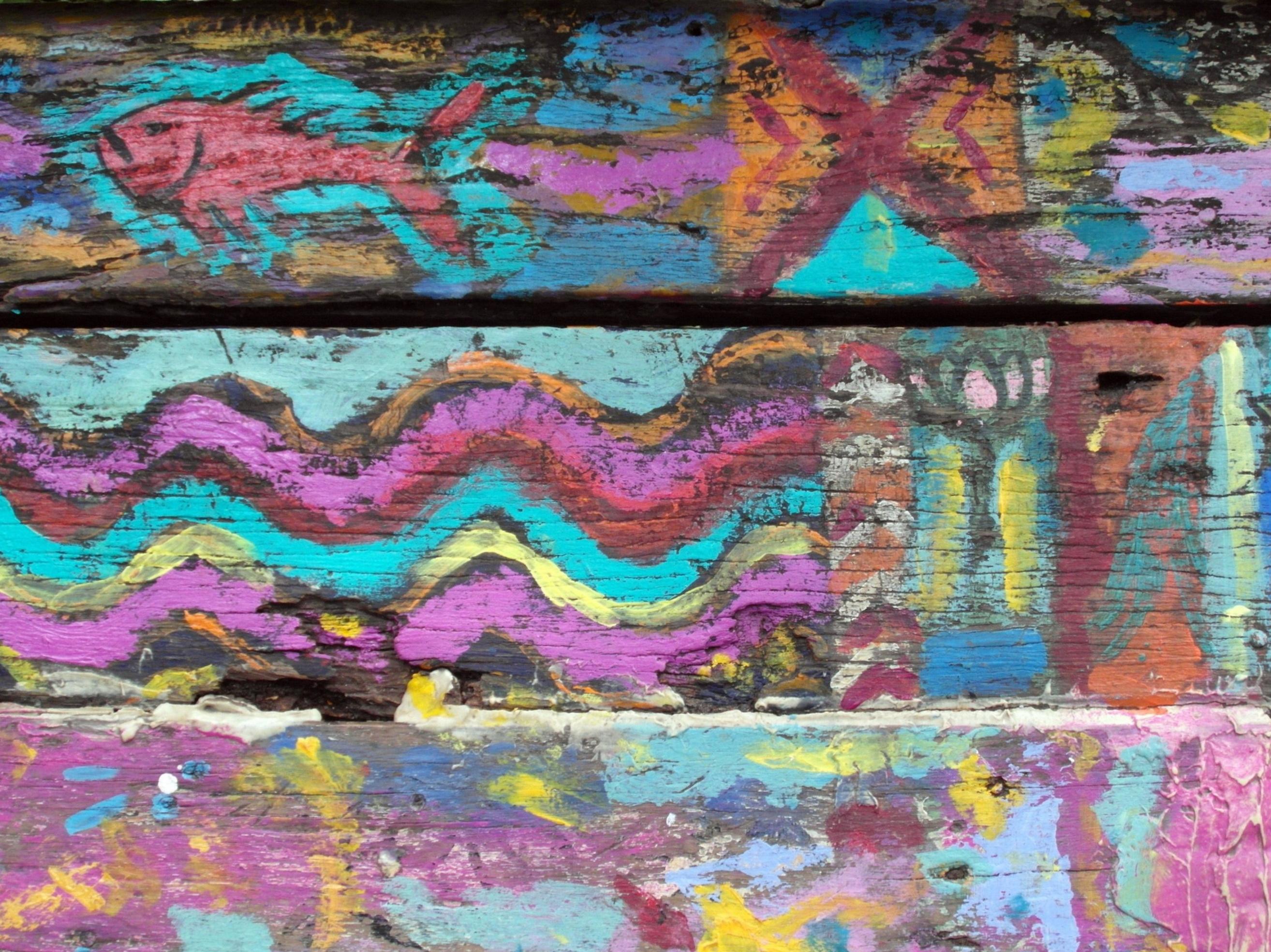 Graffiti art on wooden surface photo