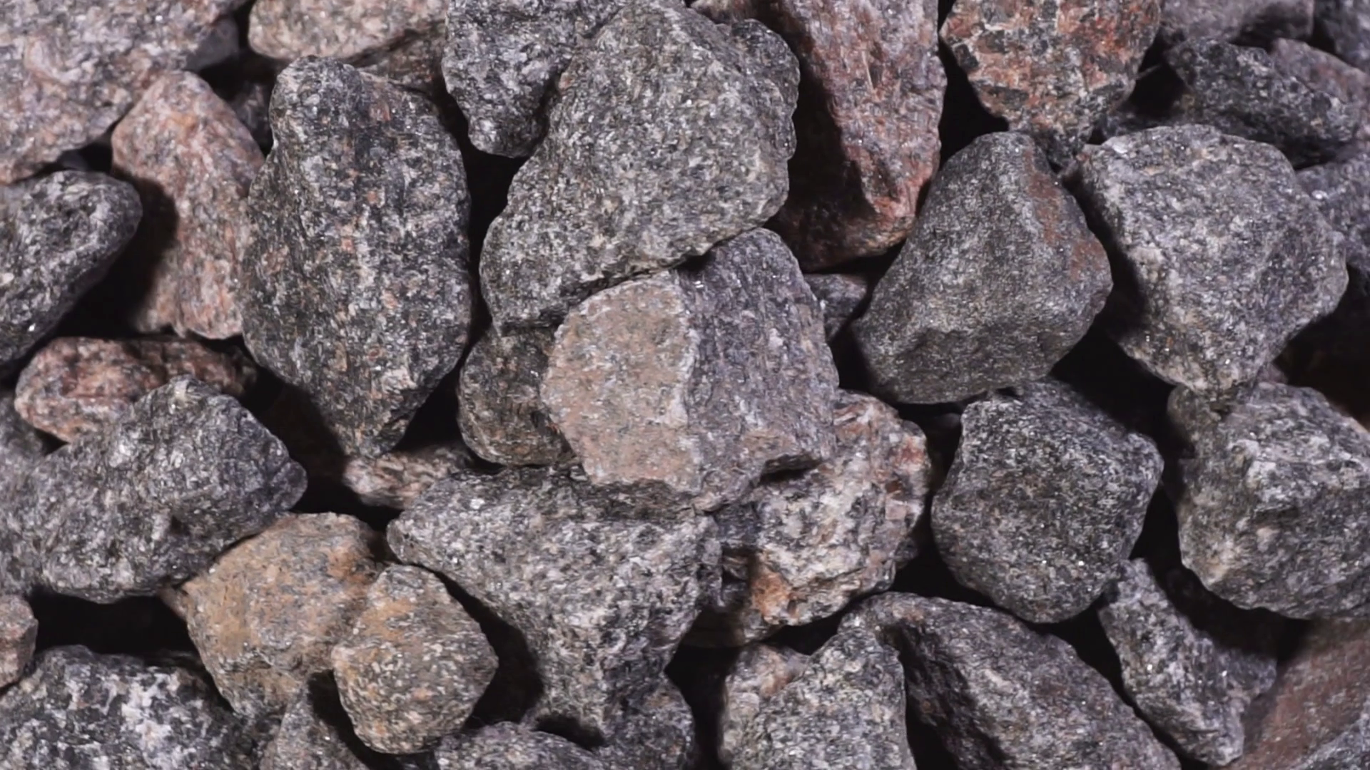 Crushed stone close-up. Granite gravel. Rubble in motion Stock Video ...