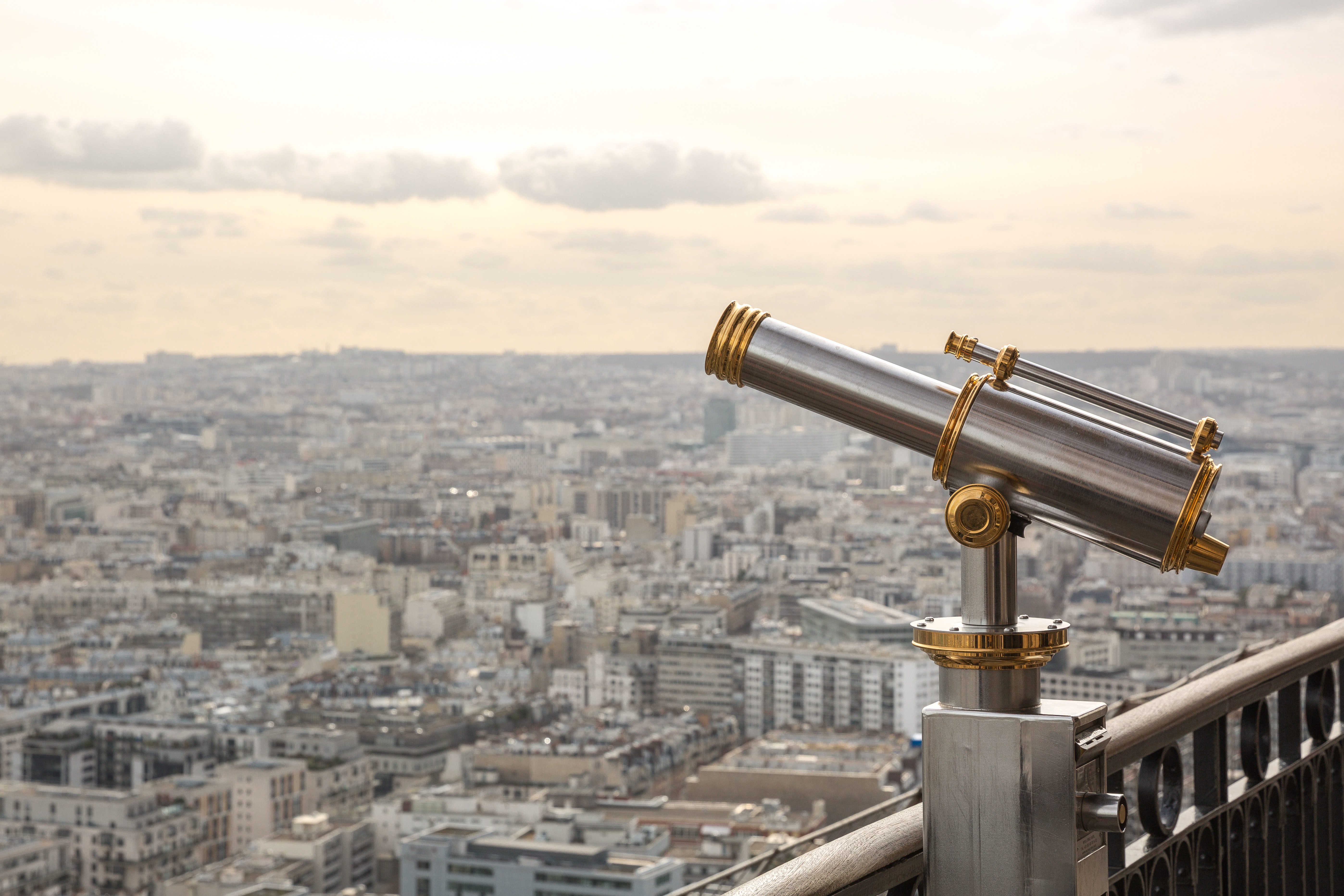 Gray and gold telescope on building photo