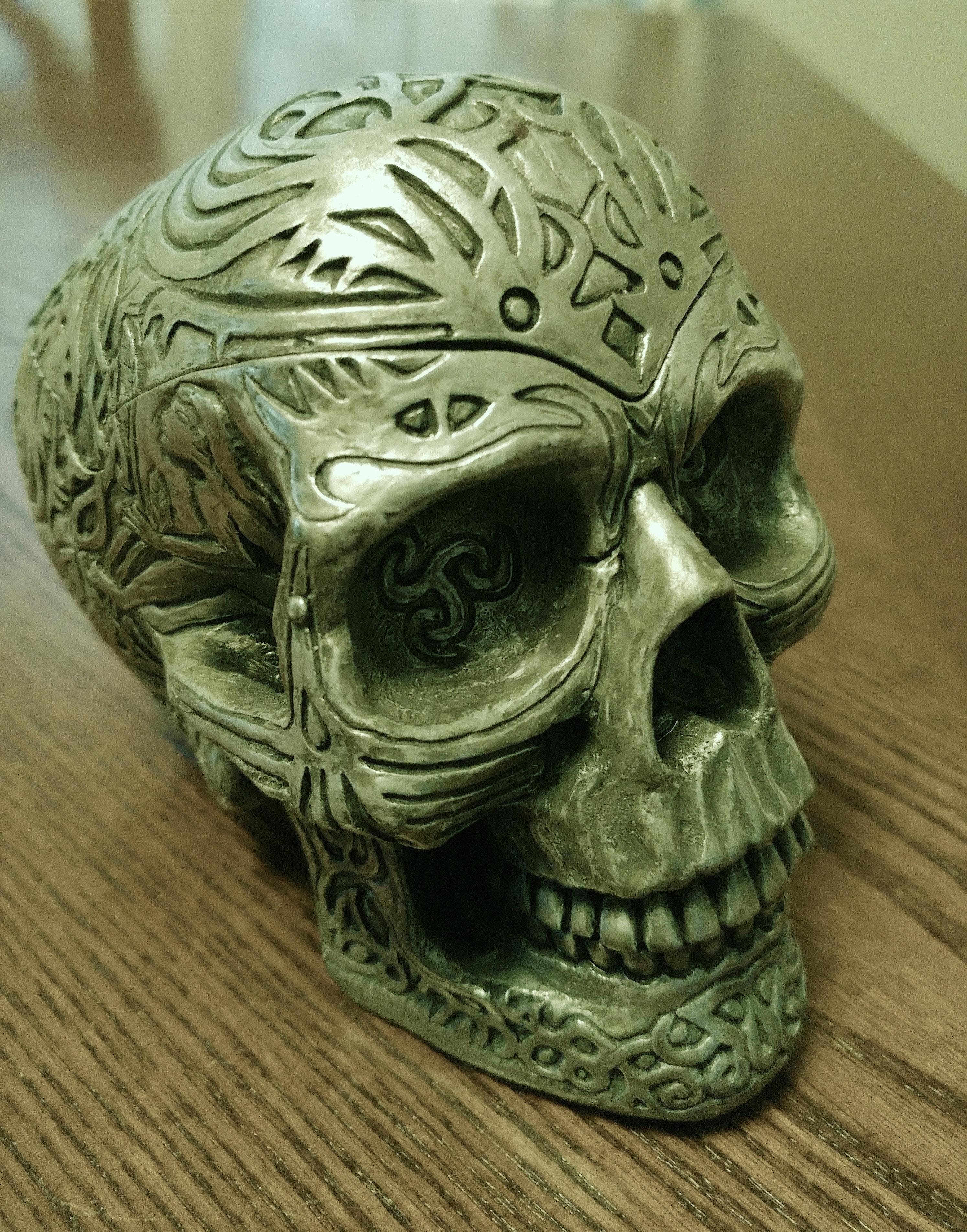 Gray ceramic skull figurine photo