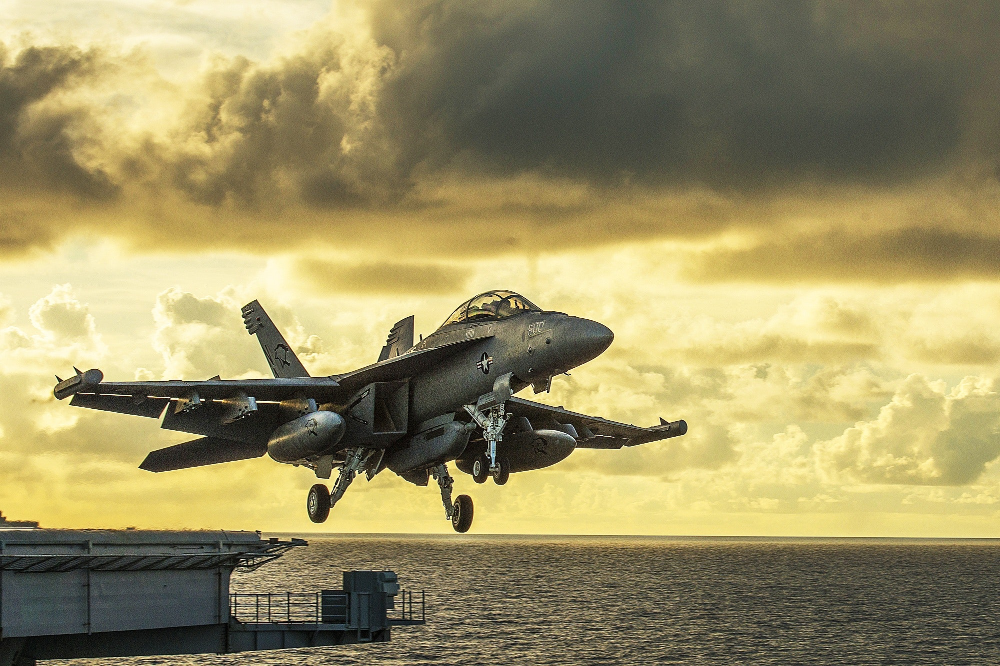 Gray combat air craft under yellow sky photo