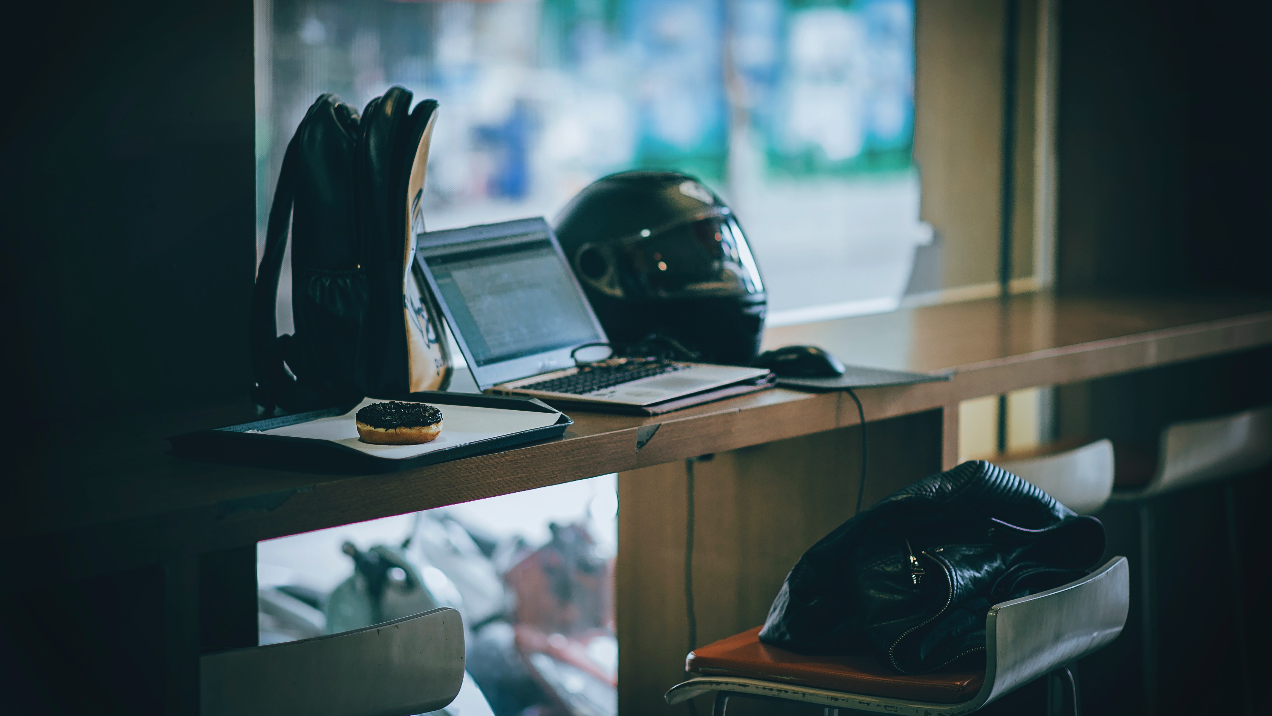 Gray laptop near black full-face helmet photo