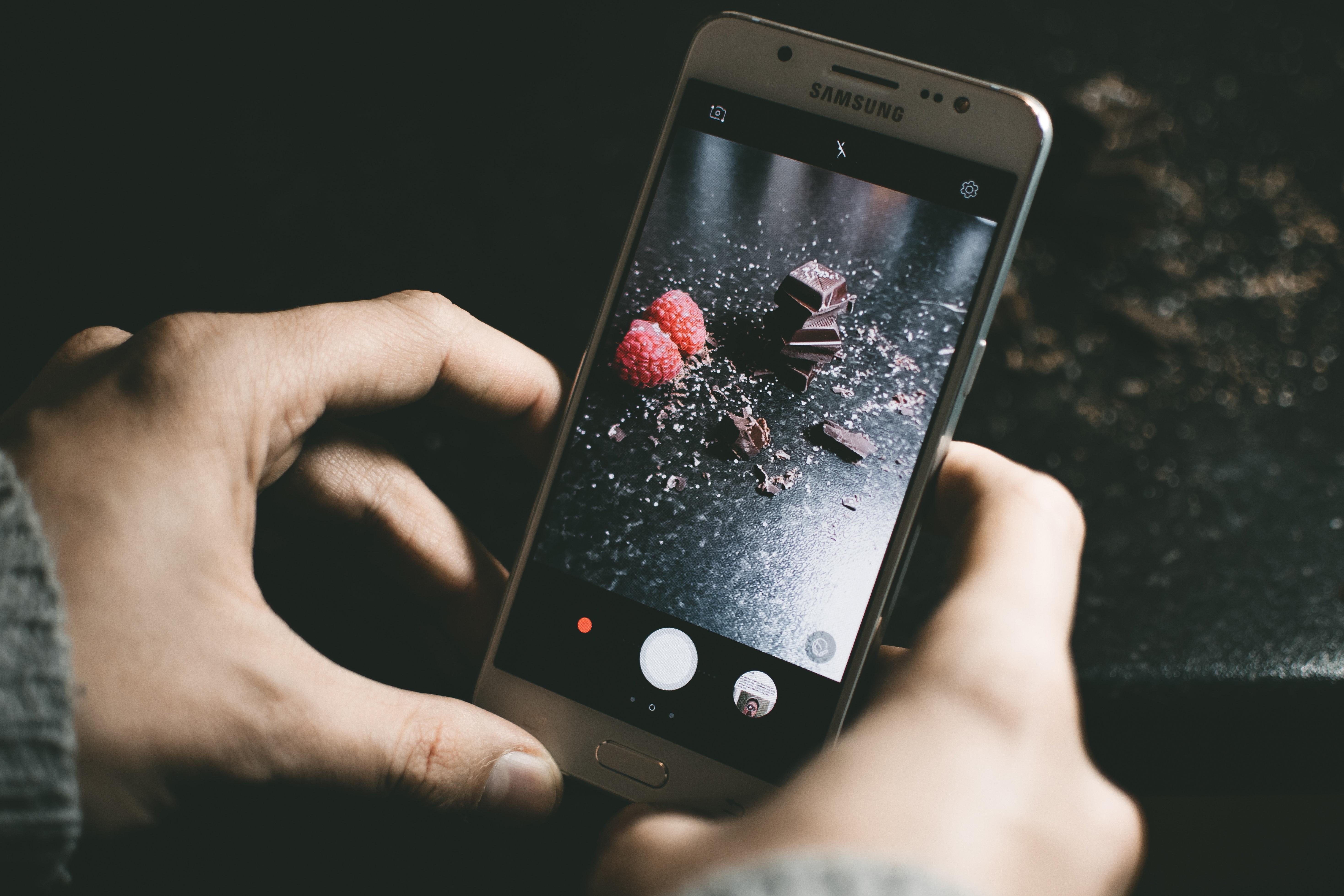 Gray samsung smartphone showing chocolates photo