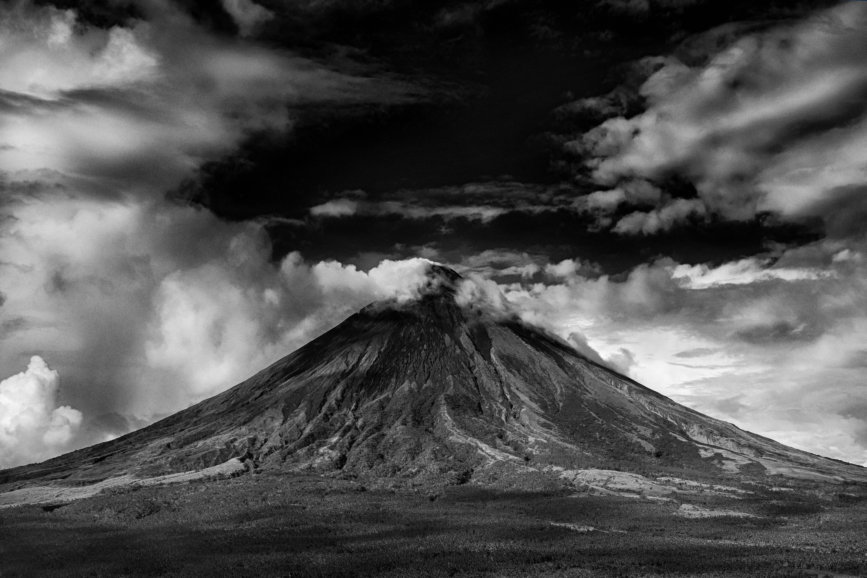 Gray scale photo of active volcano