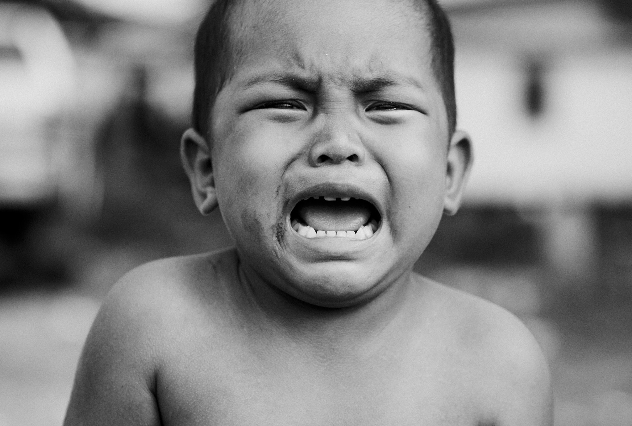 Gray scale photo of crying topless boy