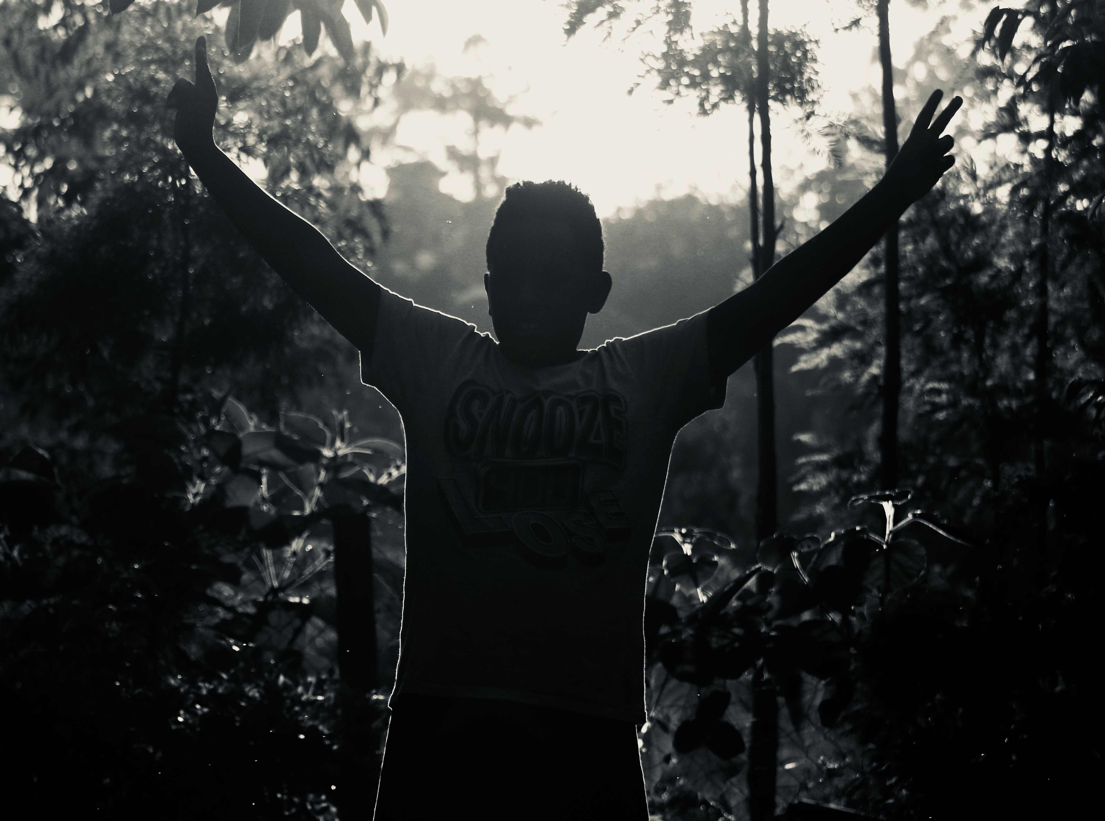 Gray Scale Photo of Man in White Shirt Raising His Hand Near Plants, Nature, Young, Wear, Trees, HQ Photo