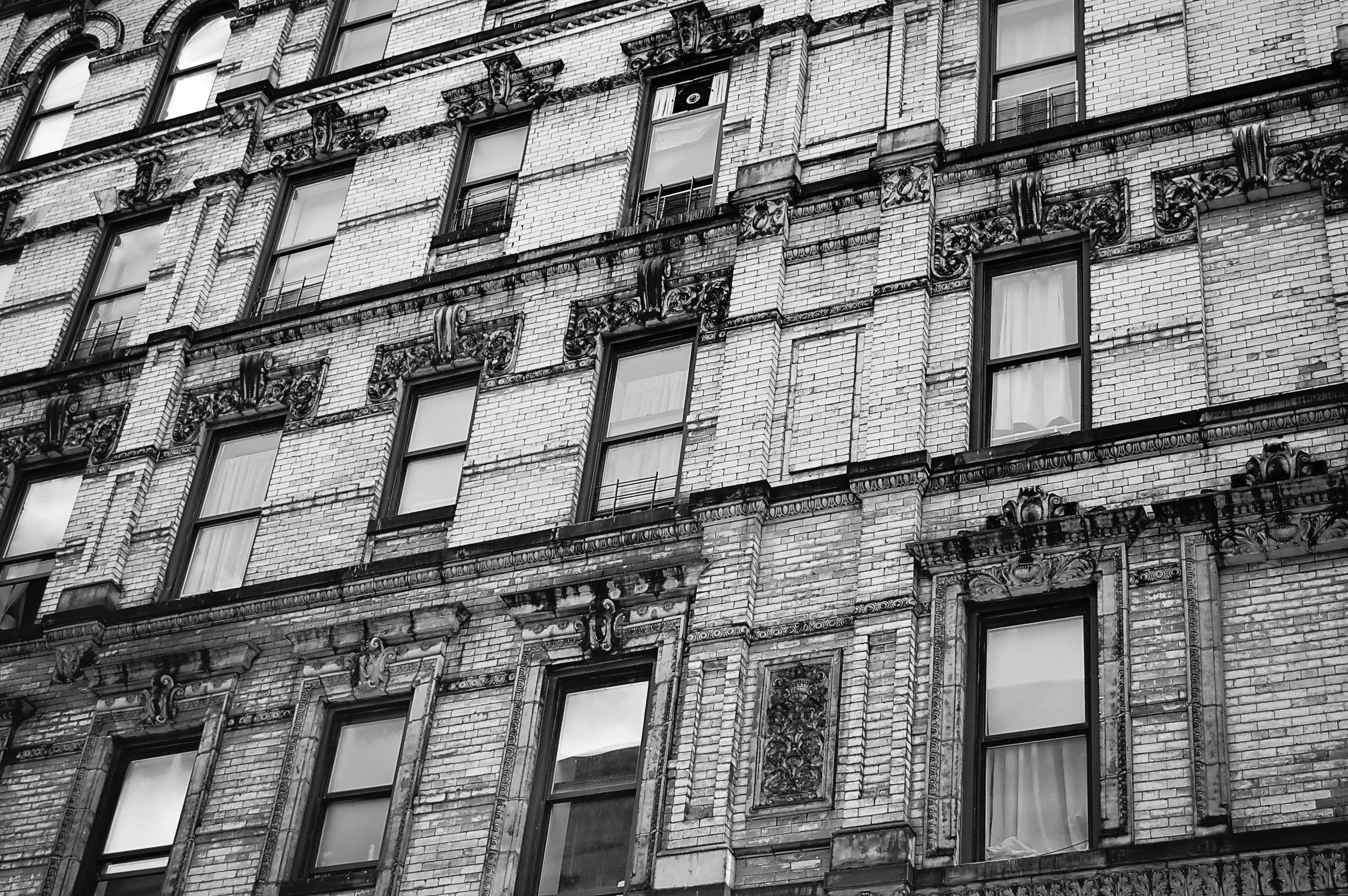 Gray scale photo of multi-storey building