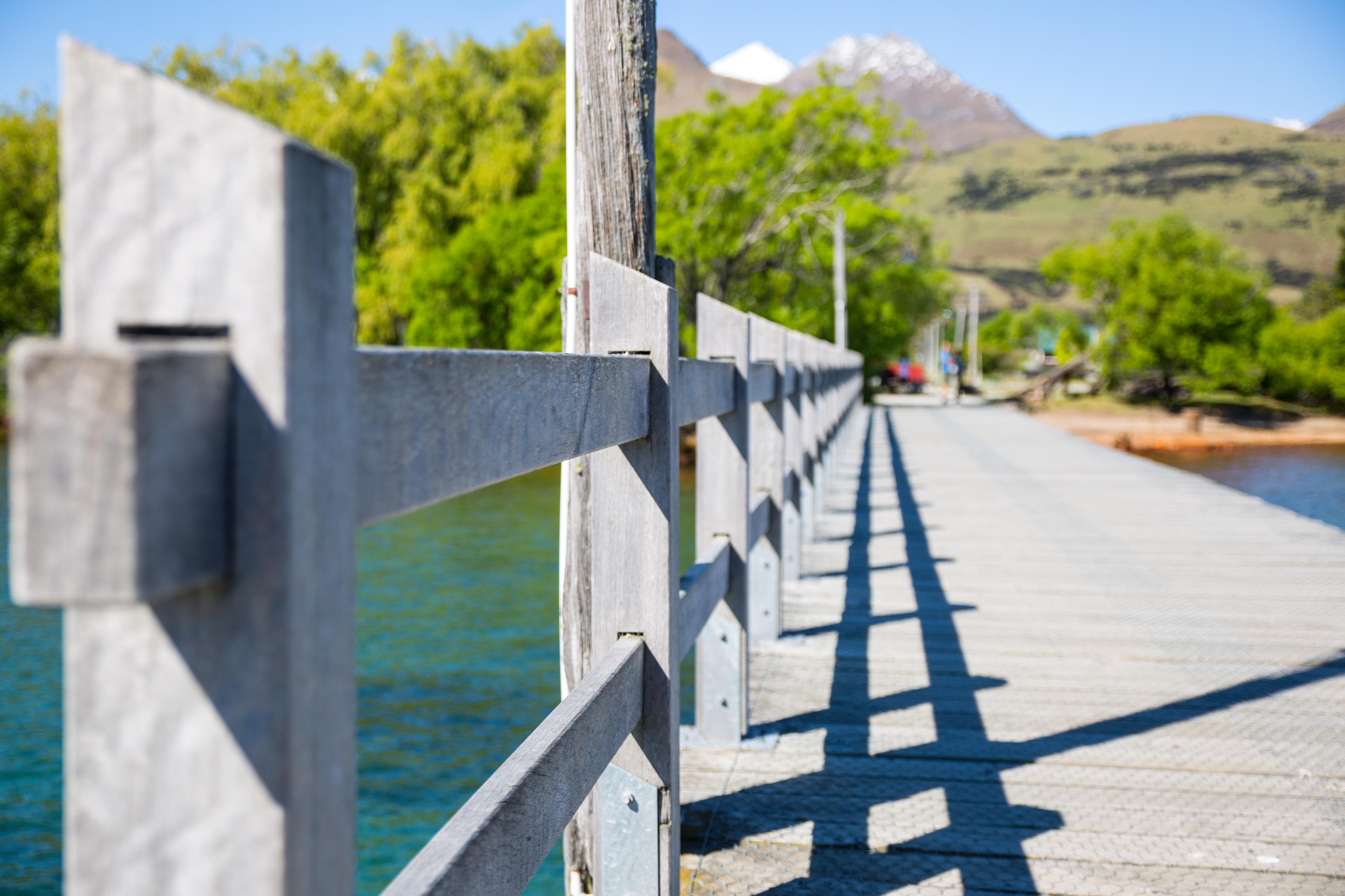 Gray wooden bridge photo
