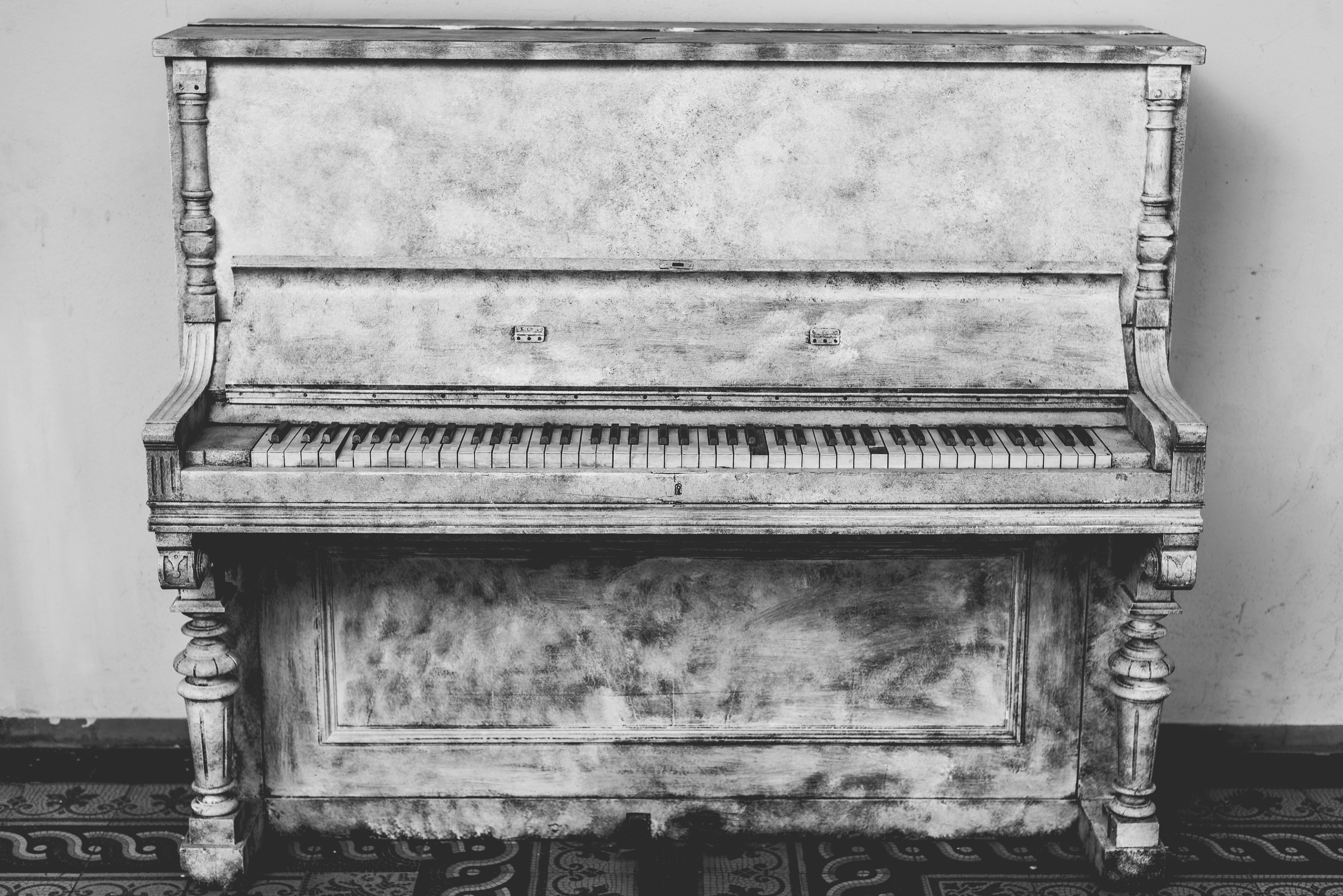 Gray wooden upright piano photo