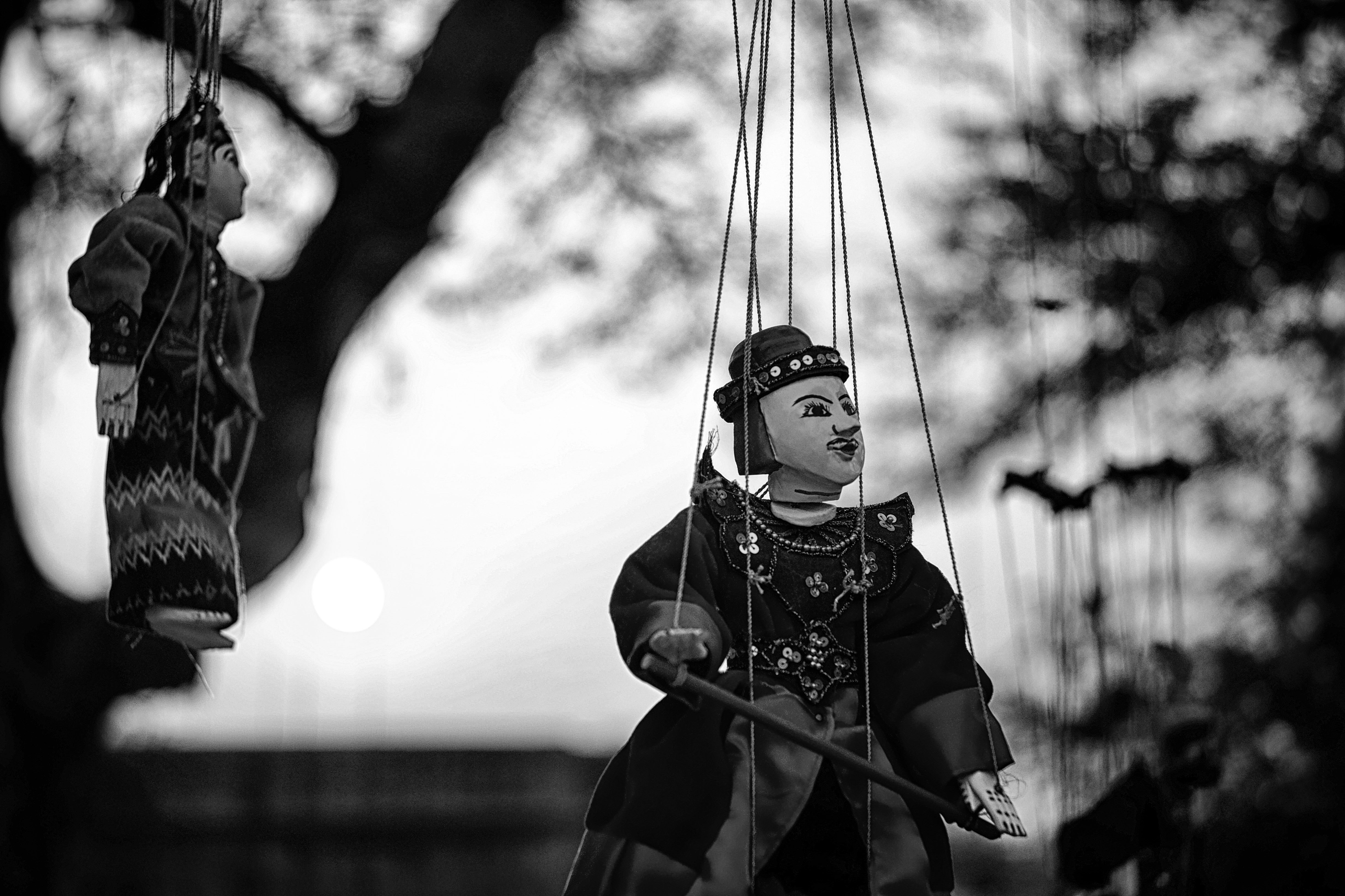 Grayscale of Two String Puppets, Black-and-white, Blurred background, Daytime, Hanging, HQ Photo