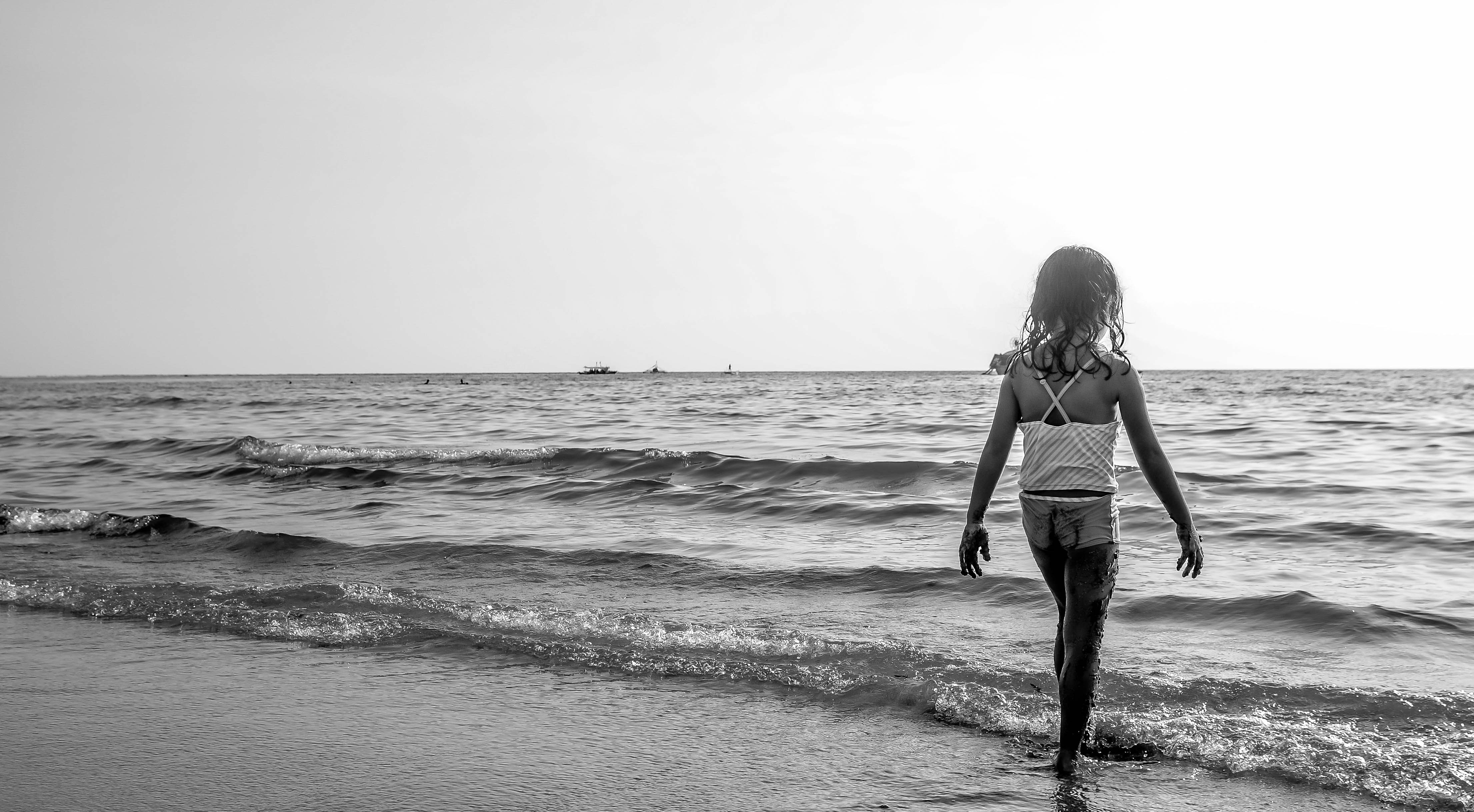 Grayscale Photo of Girl Walking on Seashore With White Spaghetti Strap Top, Beach, Sea, Waves, Water, HQ Photo