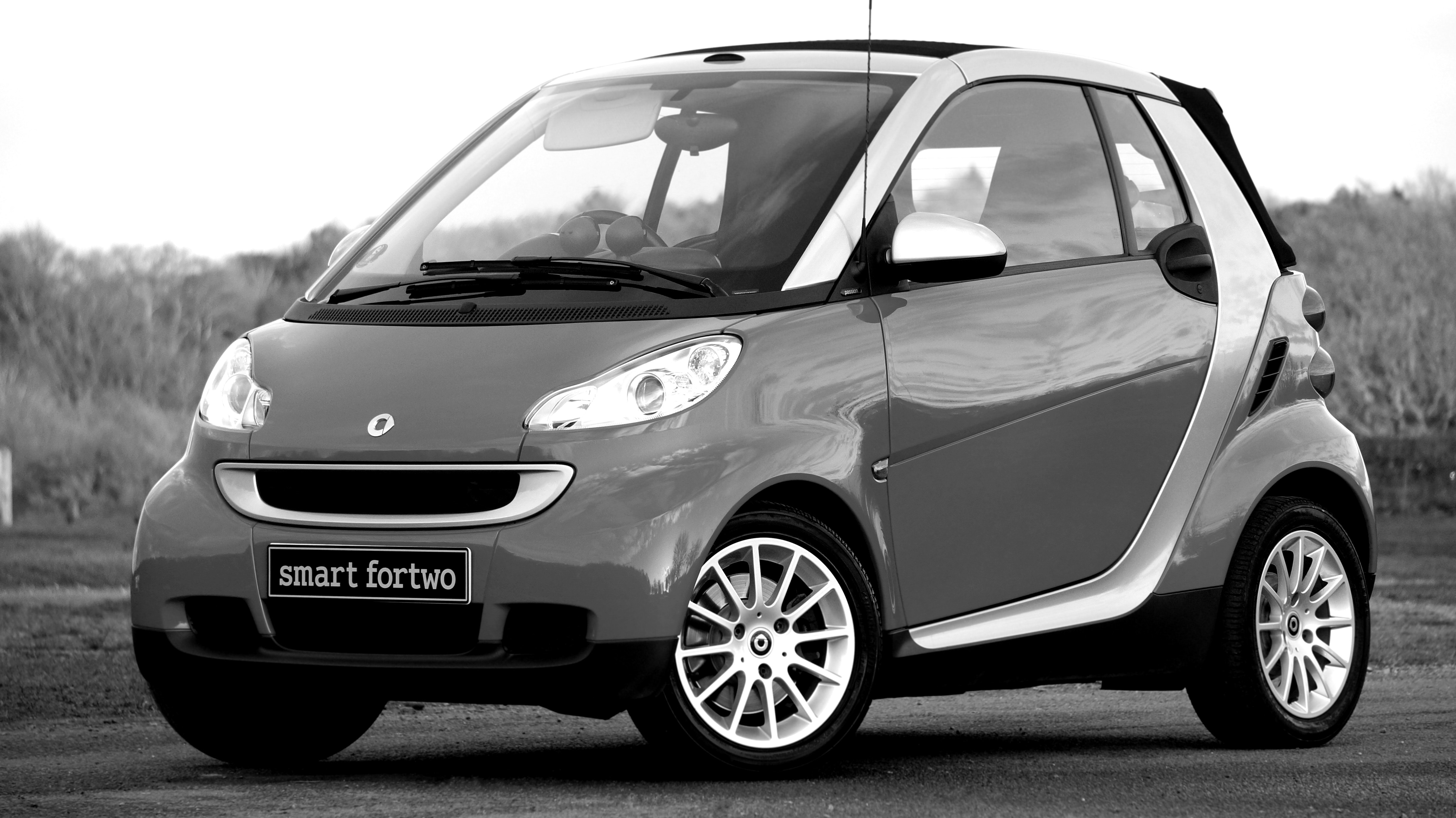 Grayscale photo of smart fortwo